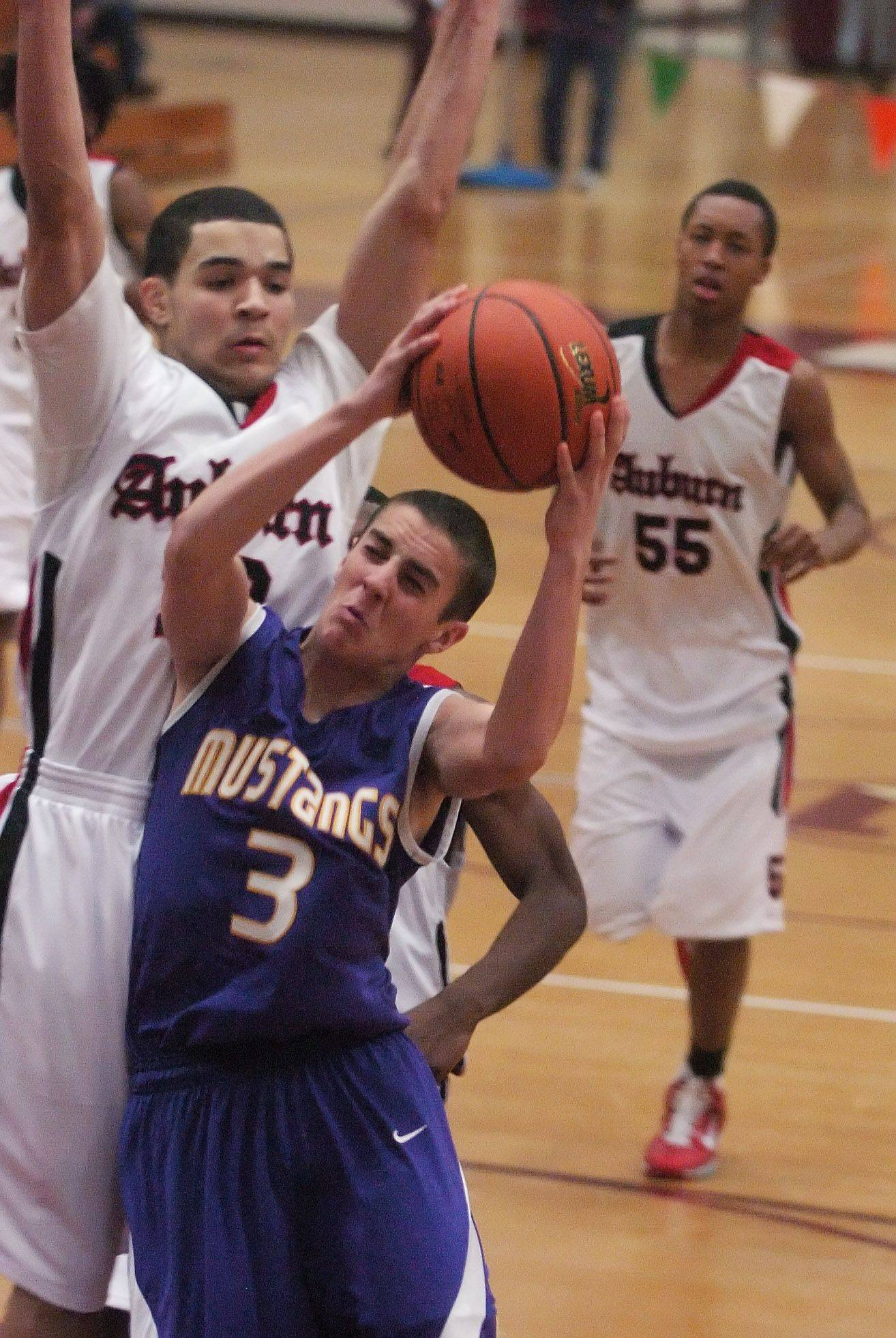 Rolling Meadows' Mike Olson drives past Rockford Auburn's Fred VanVleet during the Elgin boys basketball tournament Tuesday.