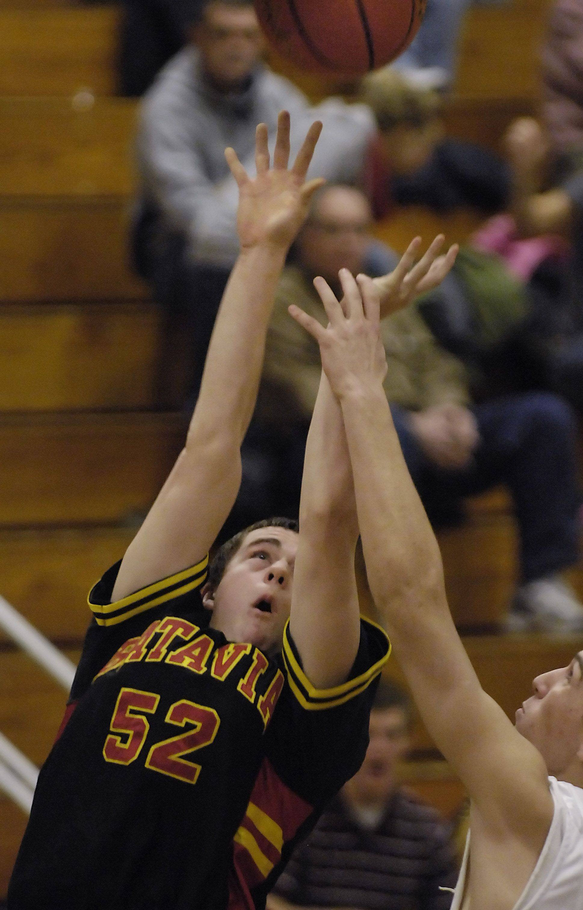 Batavia's Brady Strittmatter puts up a shot over Glenbrook South's Dusko Despot in the consolation game of the Elgin holiday tournament Thursday.