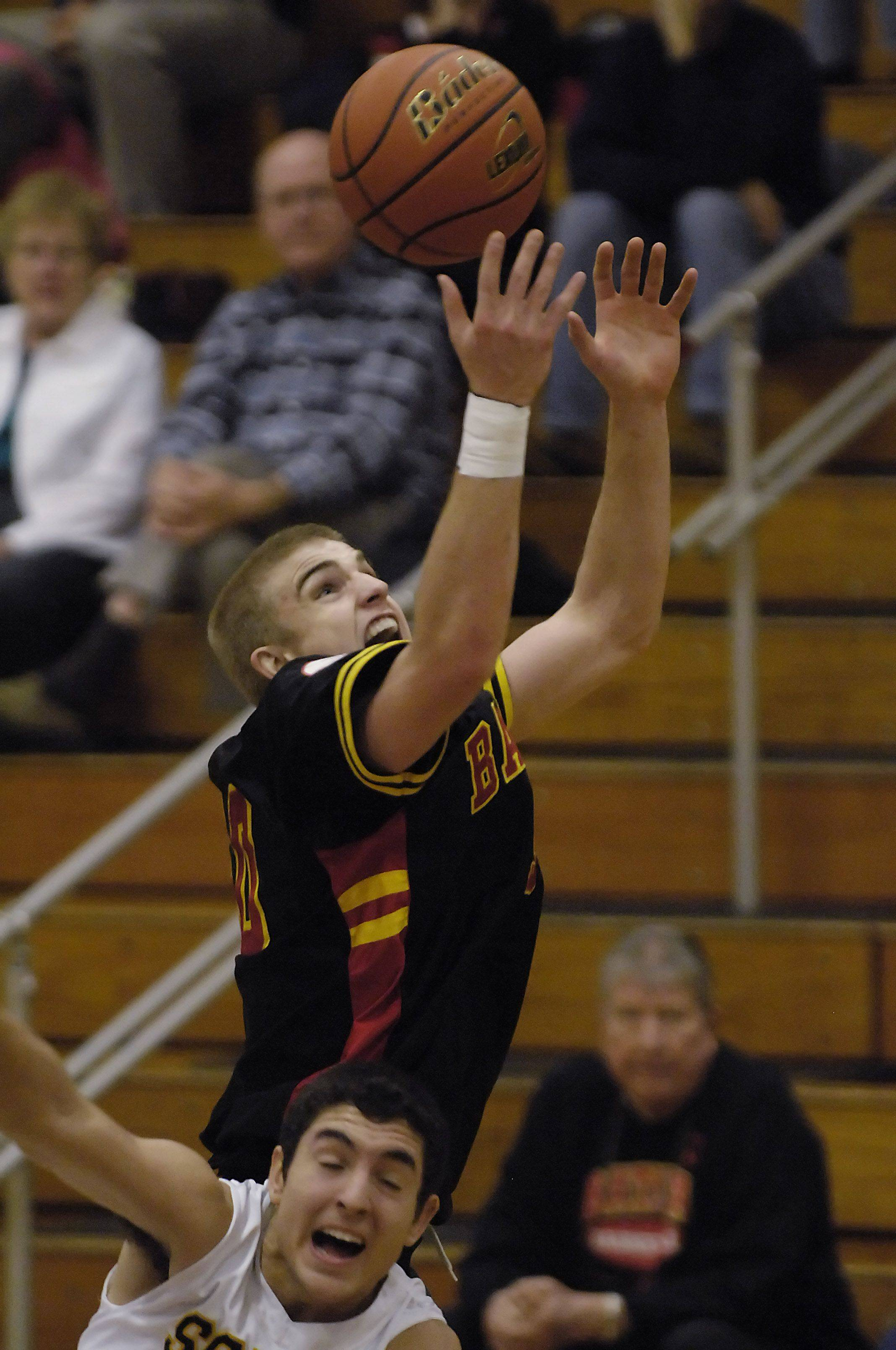 Batavia's Elliot Vaughn controls the air as he rebounds against Glenbrook South's Jessie Larabee in the consolation game of the Elgin holiday tournament Thursday.