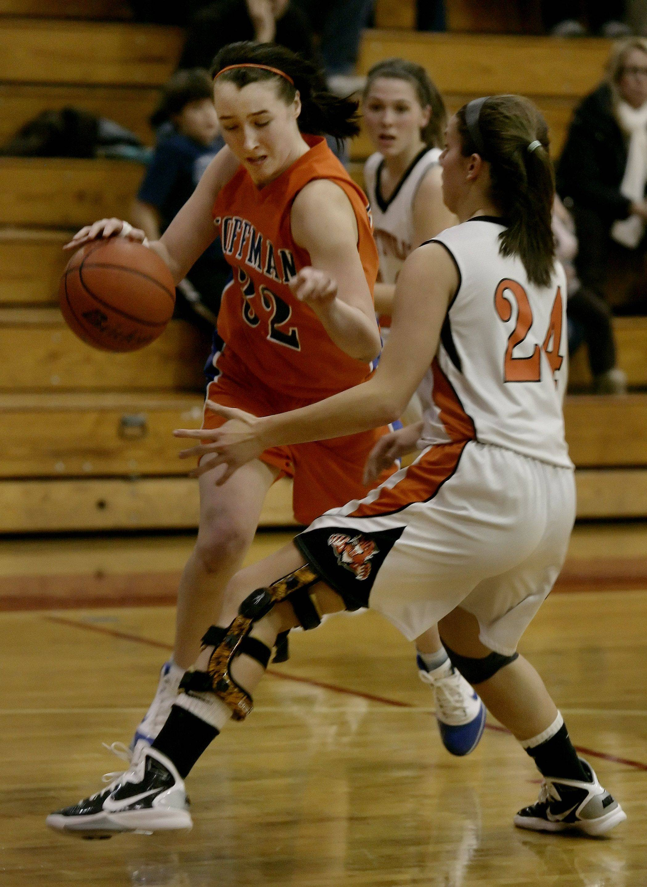 Hoffman Estates' Becca Stoczynski drives past Libertyville's Kaca Savatic during the girls basketball game Wednesday at the Lady Mustangs Holiday Classic at Mundelein High School.