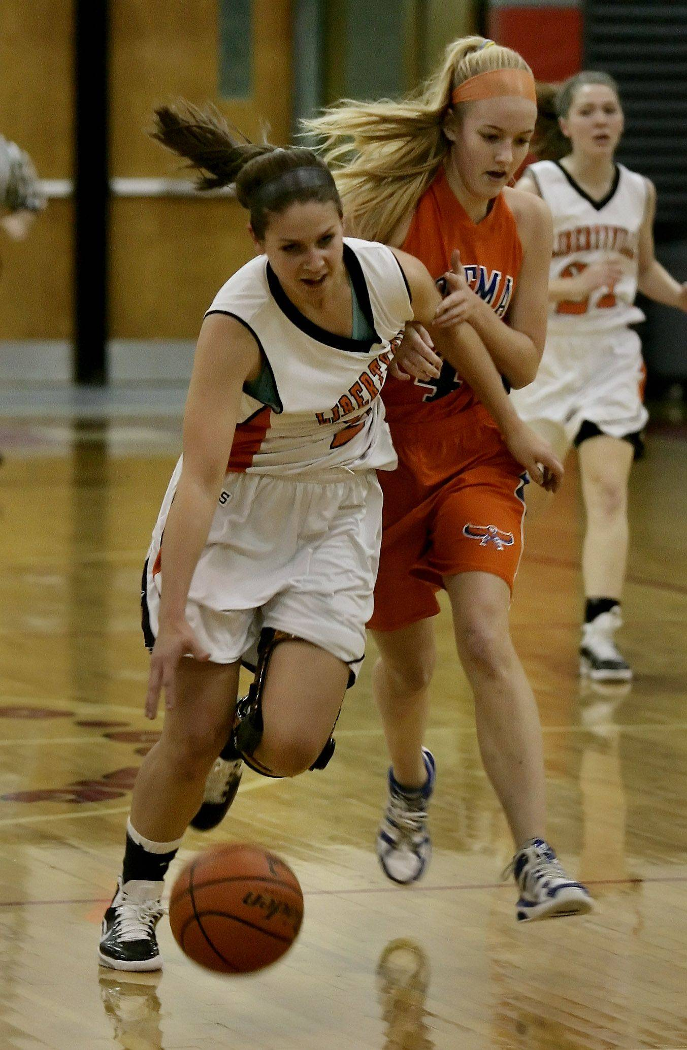 Libertyville's Kaca Savatic is fouled as she breaks away from Hoffman Estates guard Mary Pettit Wednesday in Mundelein.