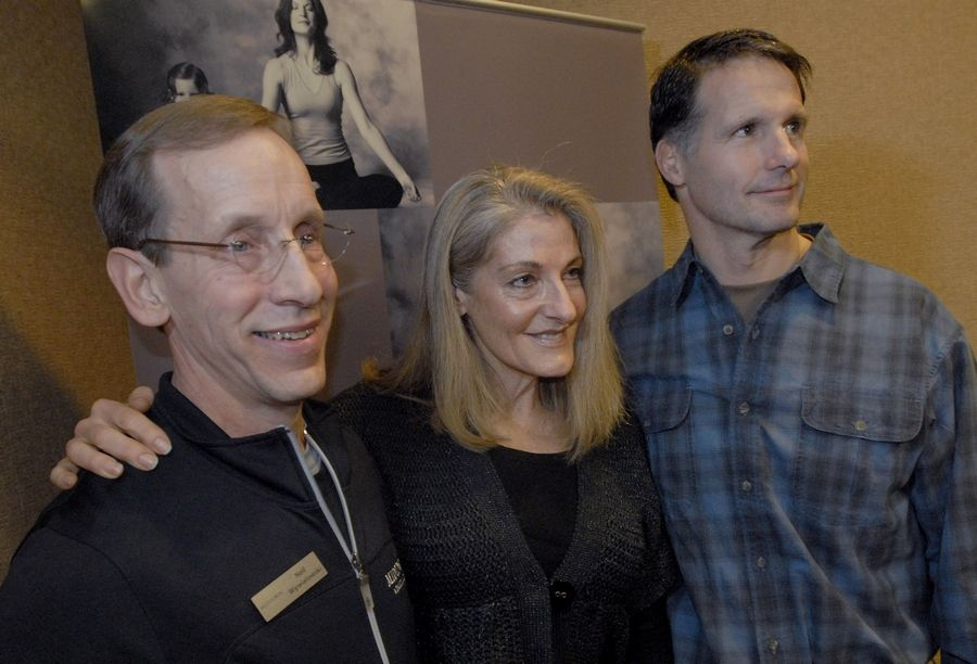 Midtown Athletic Club Fitness Director Neil Wywialowski, left, Linda Kleiss of Palatine and Tim Kirby of Long Grove were honored Wednesday by the Palatine Fire Department for their lifesaving actions.