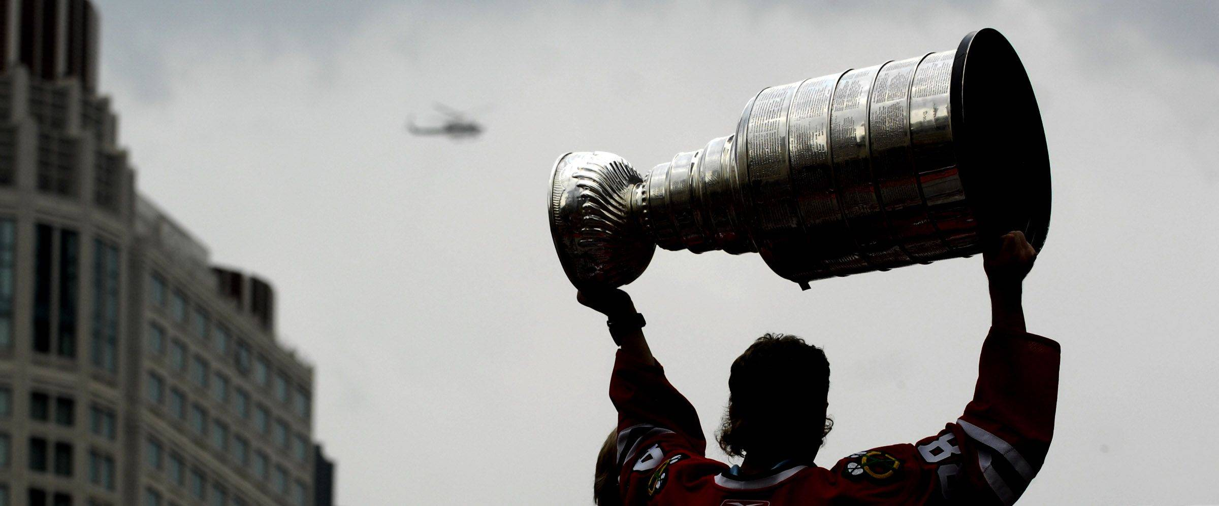 Patrick Kane hoists the Stanley Cup during Friday's victory parade for the Chicago Blackhawks following their Stanley Cup Finals win over Philadelphia.