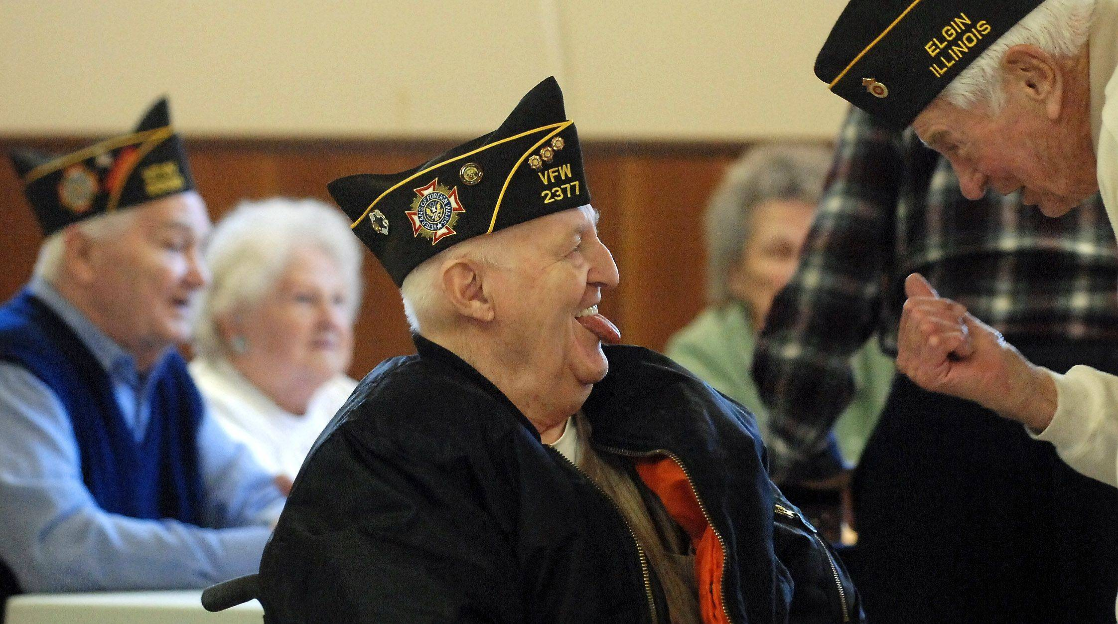 A.J. Sheehan, left, laughs as Ray Bohne leans in to tell him a story during a luncheon in honor of Pearl Harbor Day for WWII veterans hosted by VFW Post #1307 and American Legion Post #57 at the Elgin VFW Tuesday. Sheehan was in the Army and Bohne served in the Coast Guard. Both men live in Elgin.