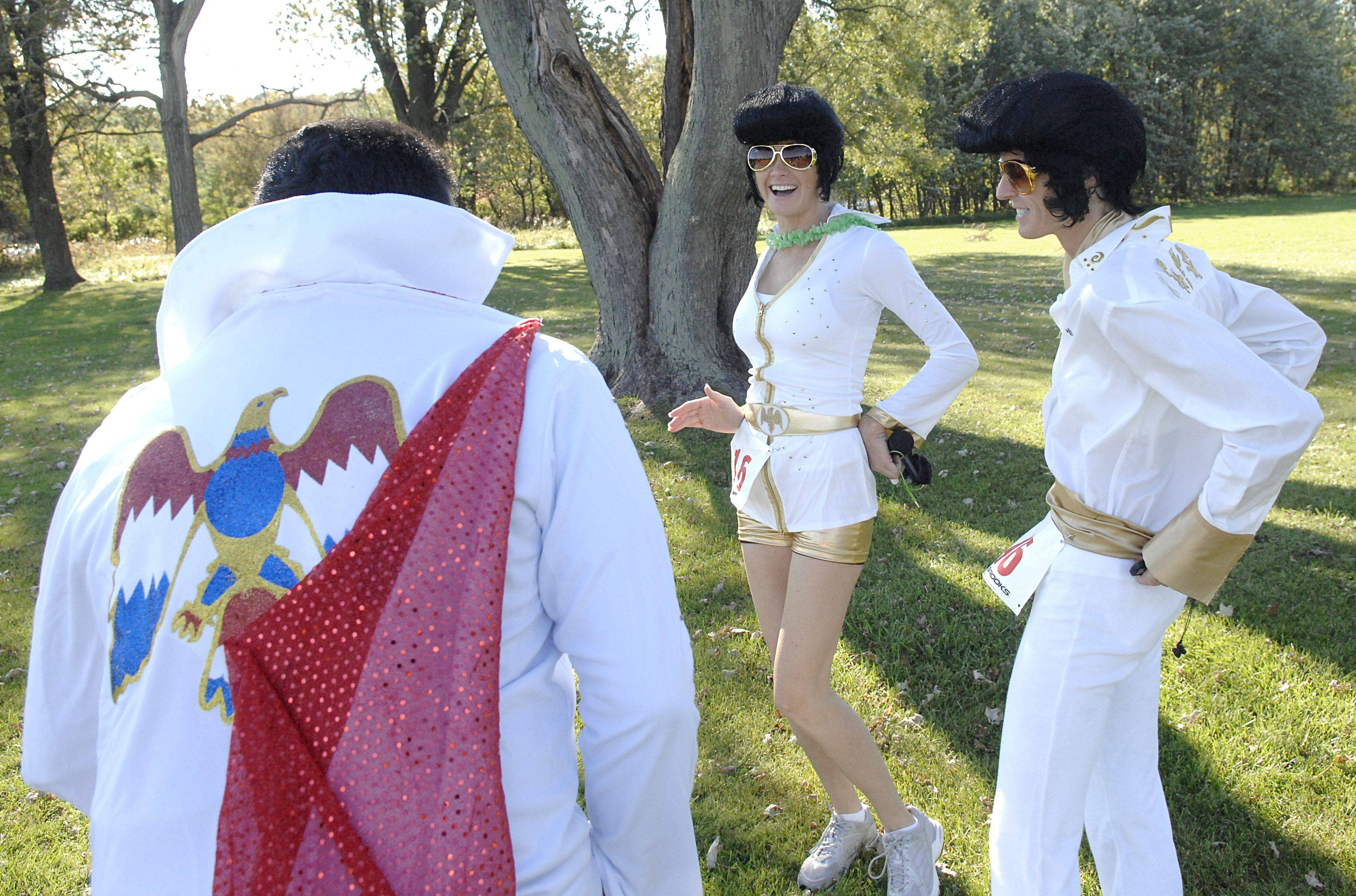 "Elvis impersonators congregate near the starting line of the Geneva Academic Foundation's ""Viva Geneva!"" 5K run and Youth Mile at the Kane County Government Center on October 2. Left to right are Willy Medina, race organizer, Jennifer Everhardus of Wilmette, and Aimee Vallero of Geneva."