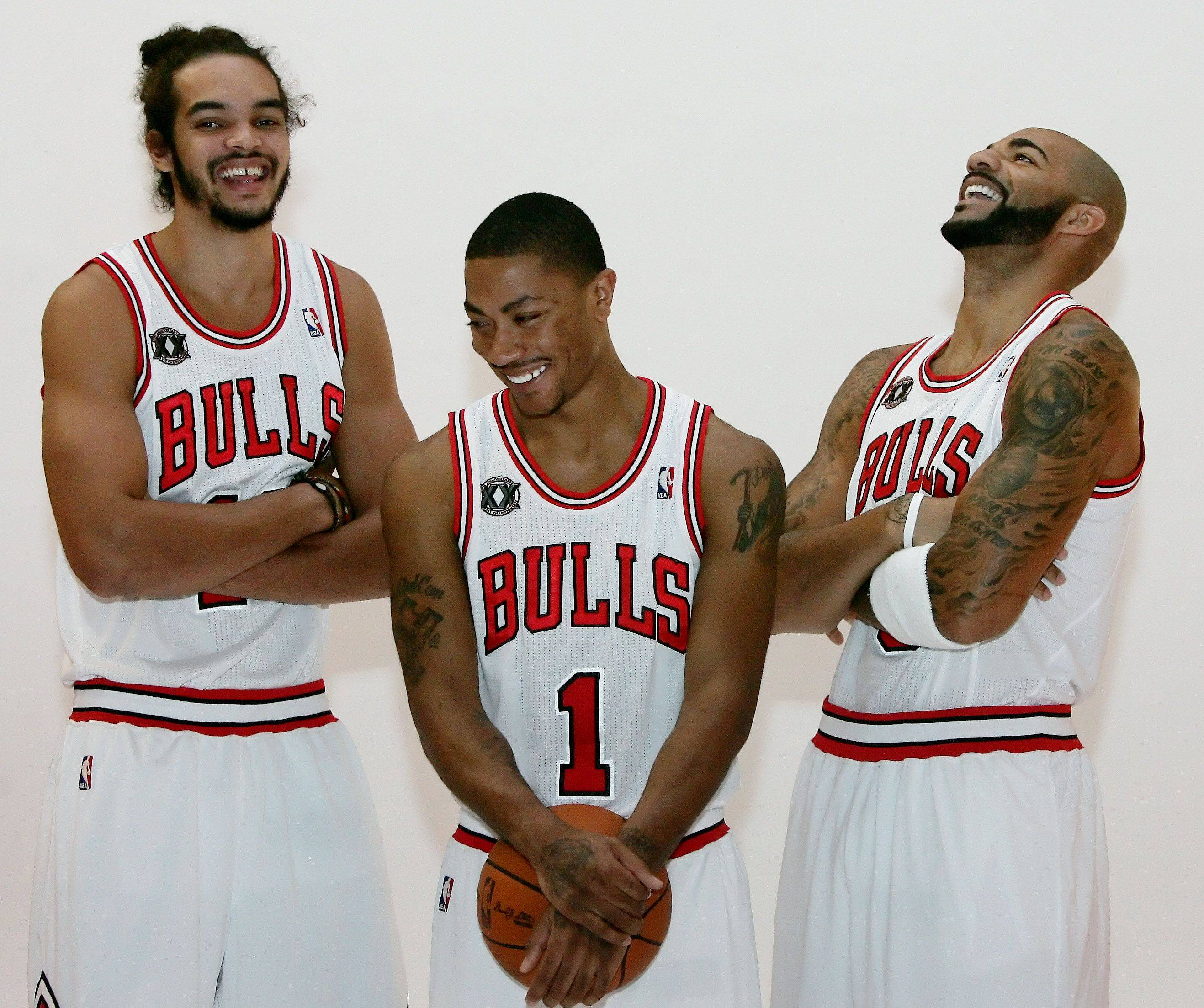 Joakim Noah, left, Derrick Rose, and Carlos Boozer joke around as they pose for pictures during the Chicago Bulls Media Day at the Berto Center in Deerfield.