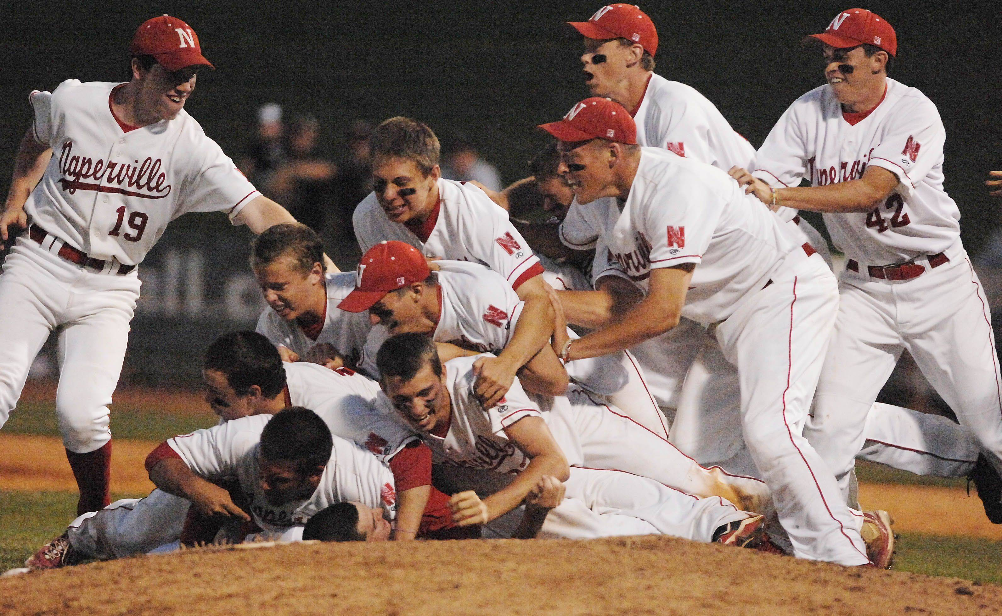 Naperville Central players celebrate after beating St. Rita in the state championship game.