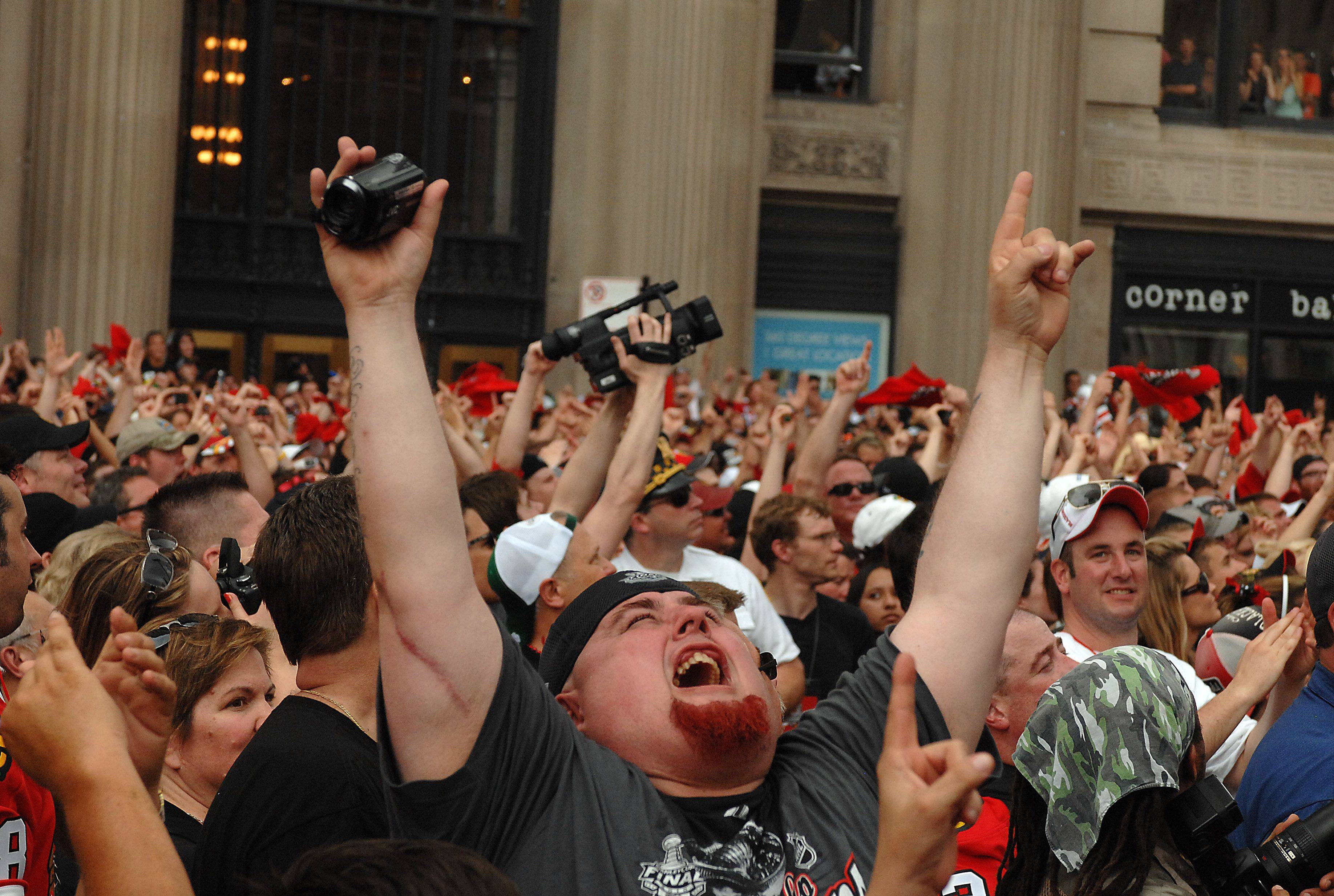 Fans cheer during the Stanley Cup victory celebration for the Blackhawks in downtown Chicago.