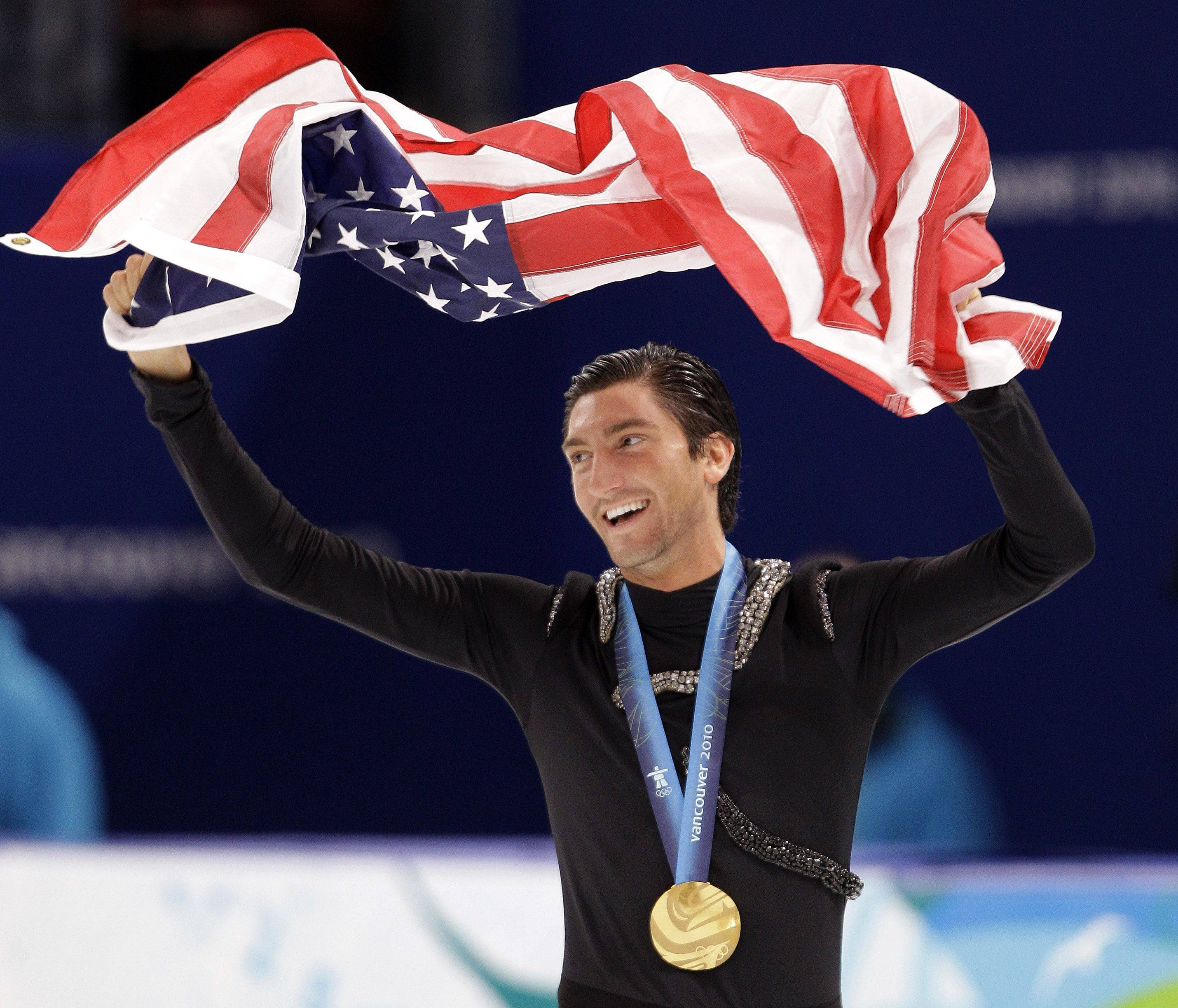 Naperville native Evan Lysacek waves the U.S. flag during the victory ceremony after winning gold at the Vancouver 2010 Olympics in February.