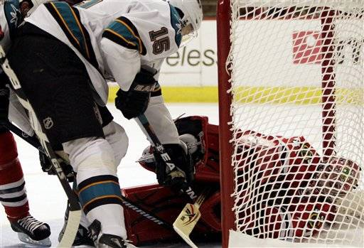 Chicago Blackhawks goalie Marty Turco, right, saves a shot by San Jose Sharks' Dany Heatley (15) during the first period Thursday.