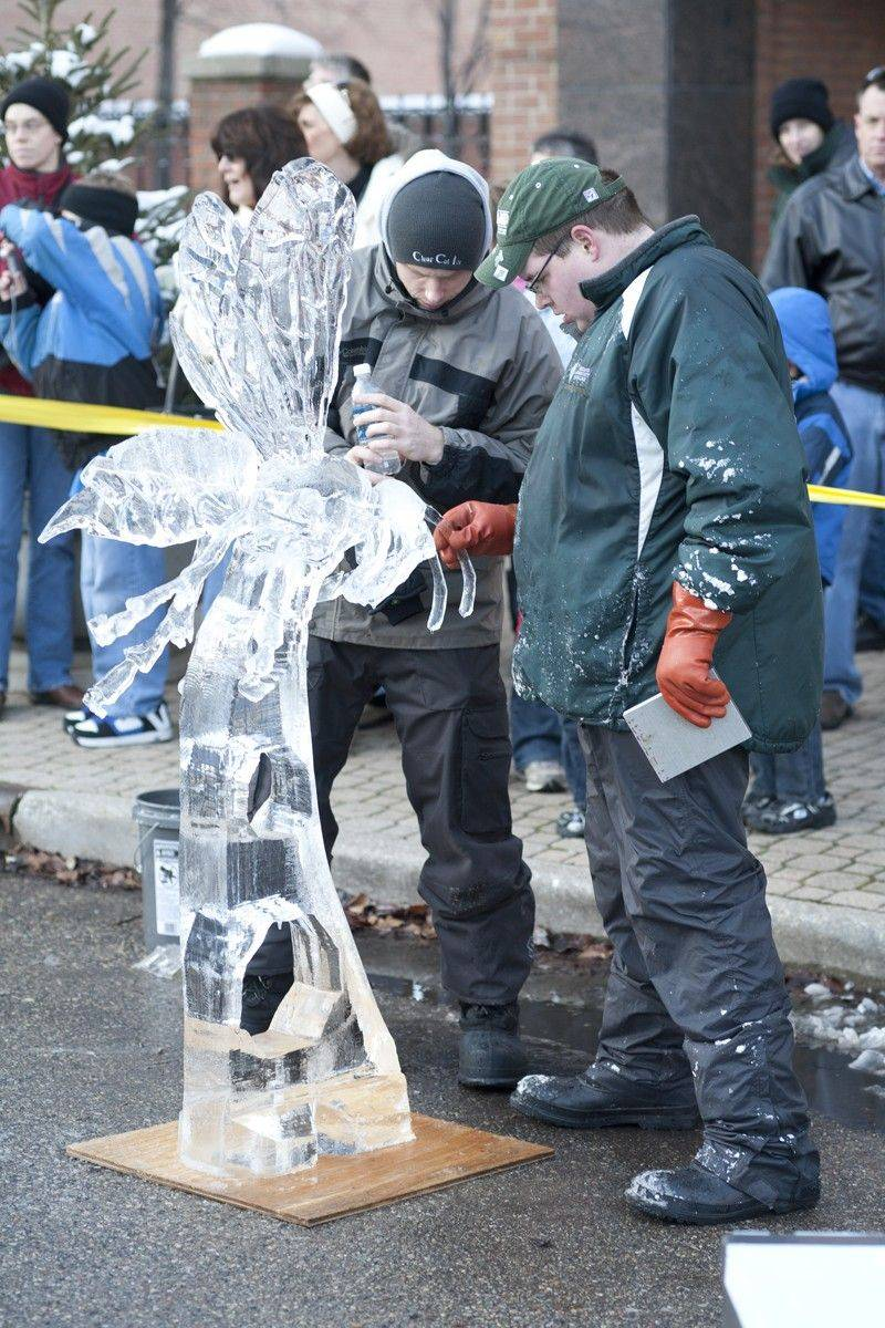 College students from around the Midwest compete at the Collegiate Ice Sculpting Invitational in downtown Holland, Mich.