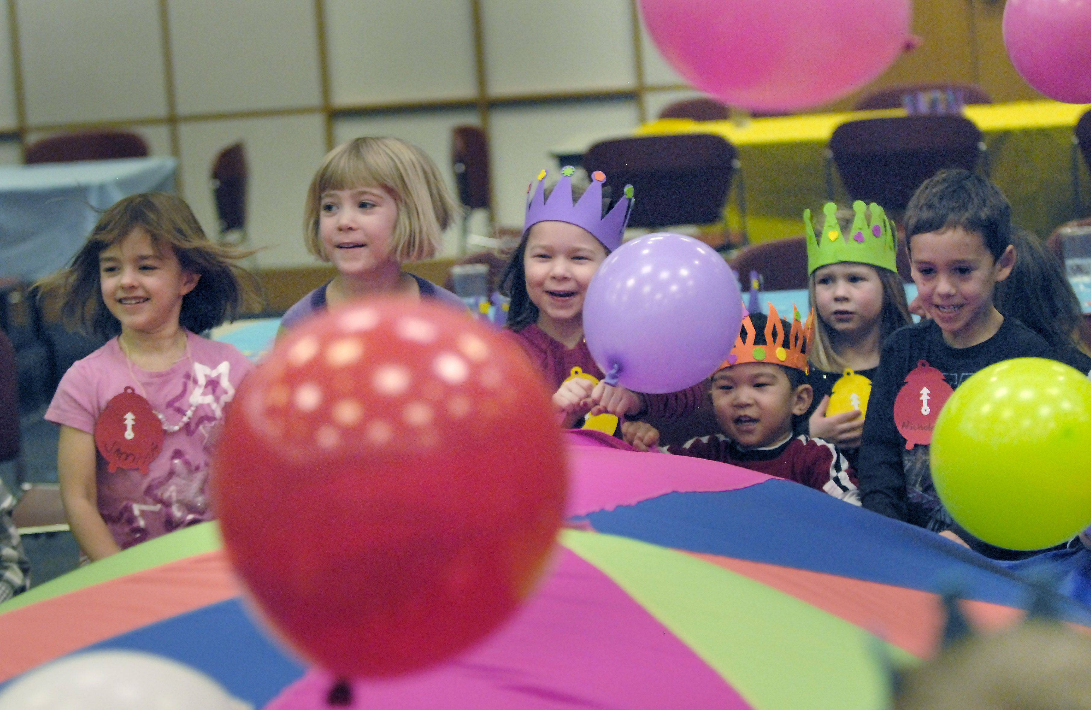 Balloons bounce away at the end of the celebration Friday during the Almost New Year's party at the Arlington Heights Memorial Library.