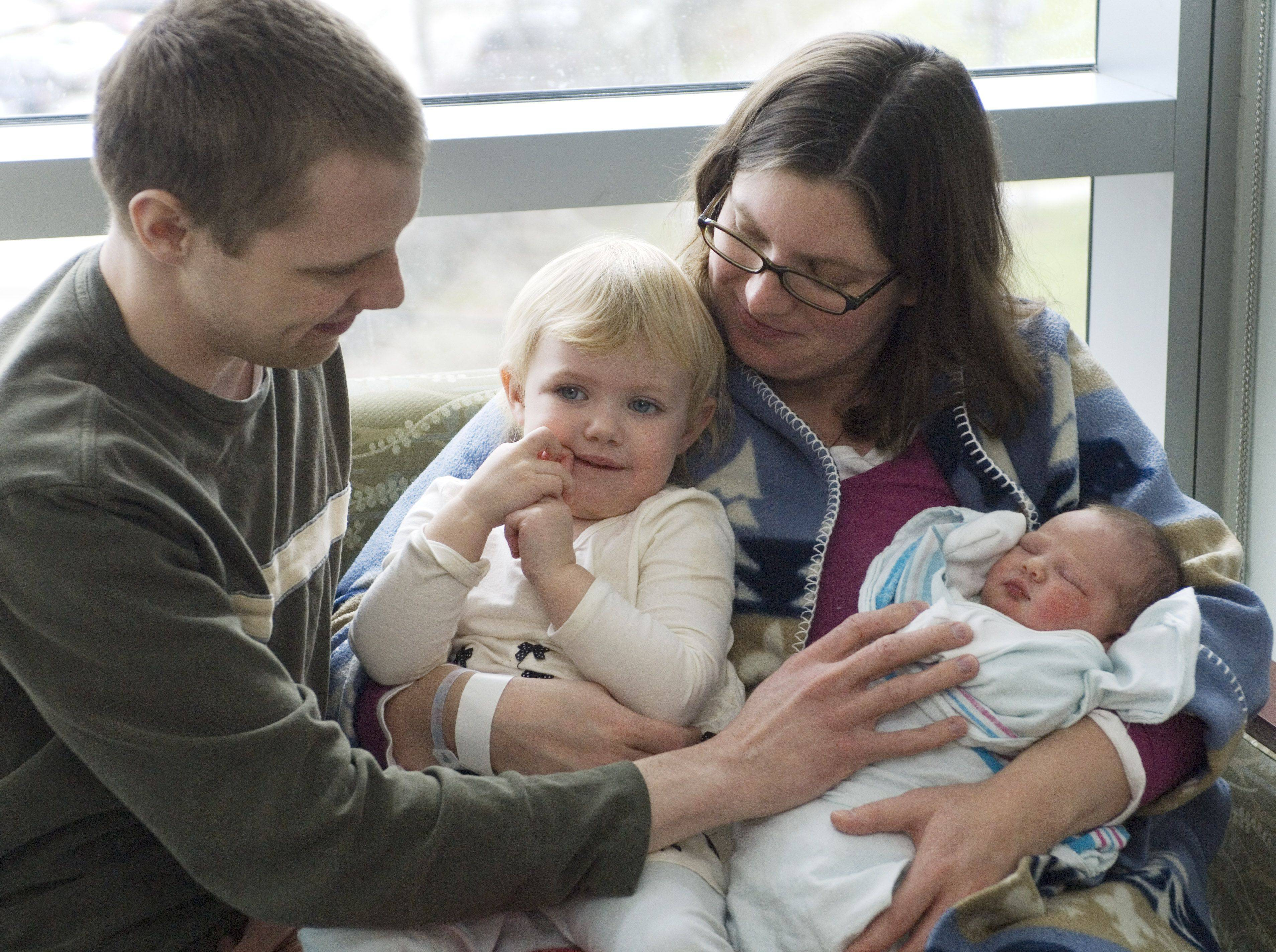 Ron and Rosie Haaker enjoy the arrival of newborn Mary Haaker along with Mary's sister Molly, 2, at Northwest Community Hospital Saturday morning.