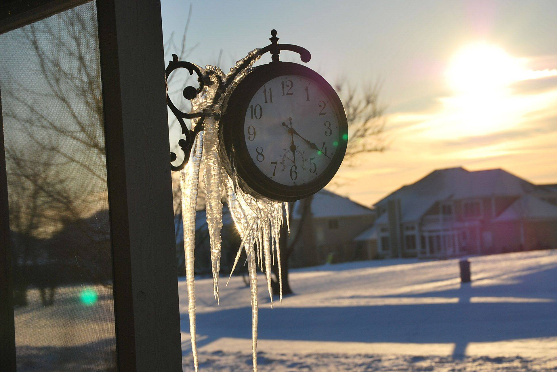 Photo of a clock hanging off her screen porch.