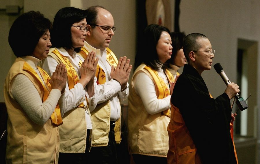 The Heart Sutra, led by Venerable Manpou, far right, of the Chicago chapter of Buddha's Light International Association was part of the sixth annual World Peace Day interfaith prayer service Sunday. More than 100 people participated at First Congregational United Church of Christ in Naperville.