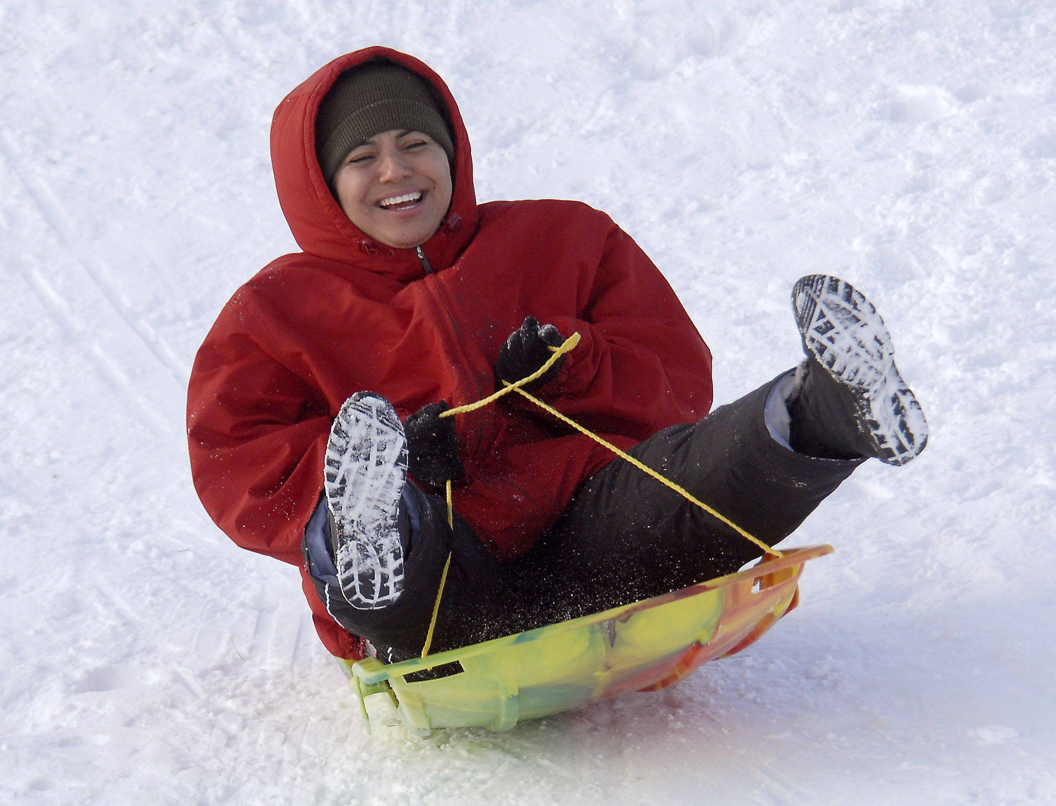 Maria Trejo of Rolling Meadows tries her first time sledding on the hill in Sunset Park Monday afternoon.