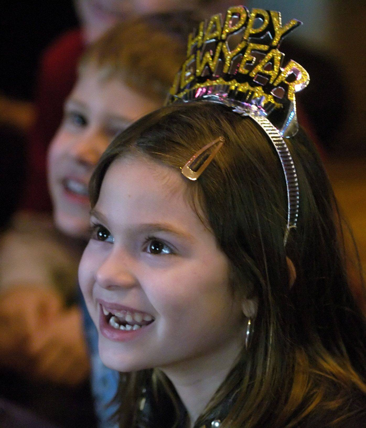 Kyra Hatch, 7, of Des Plaines watches the magic show during a New Year's Eve party at Blues Bar, hosted by the Mount Prospect Downtown Merchants Association.