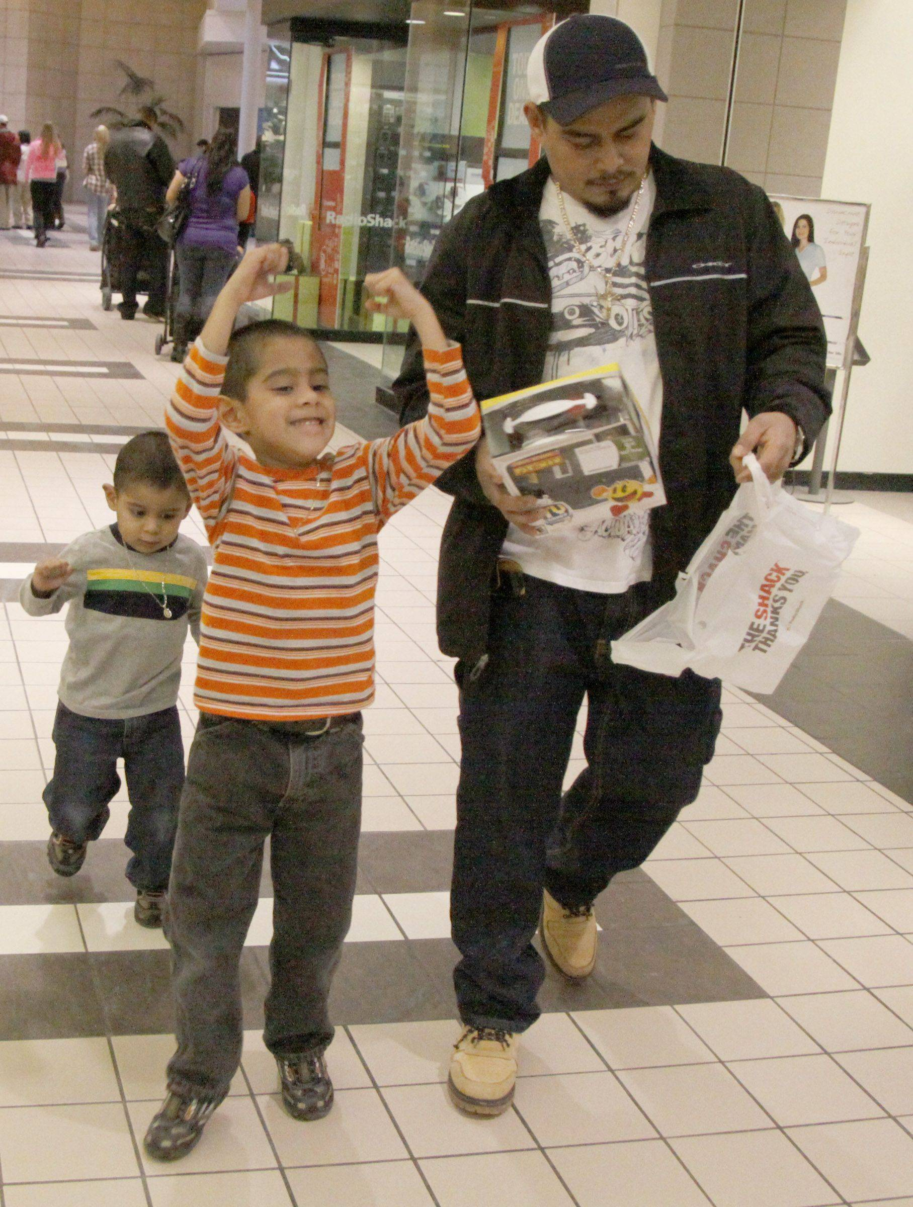 Daniel Bautista Jr., 6, of Elgin was full of glee after his father Daniel brought him and his brother Johan, 3, to Spring Hill Mall in West Dundee to buy a Pac Man game Sunday.
