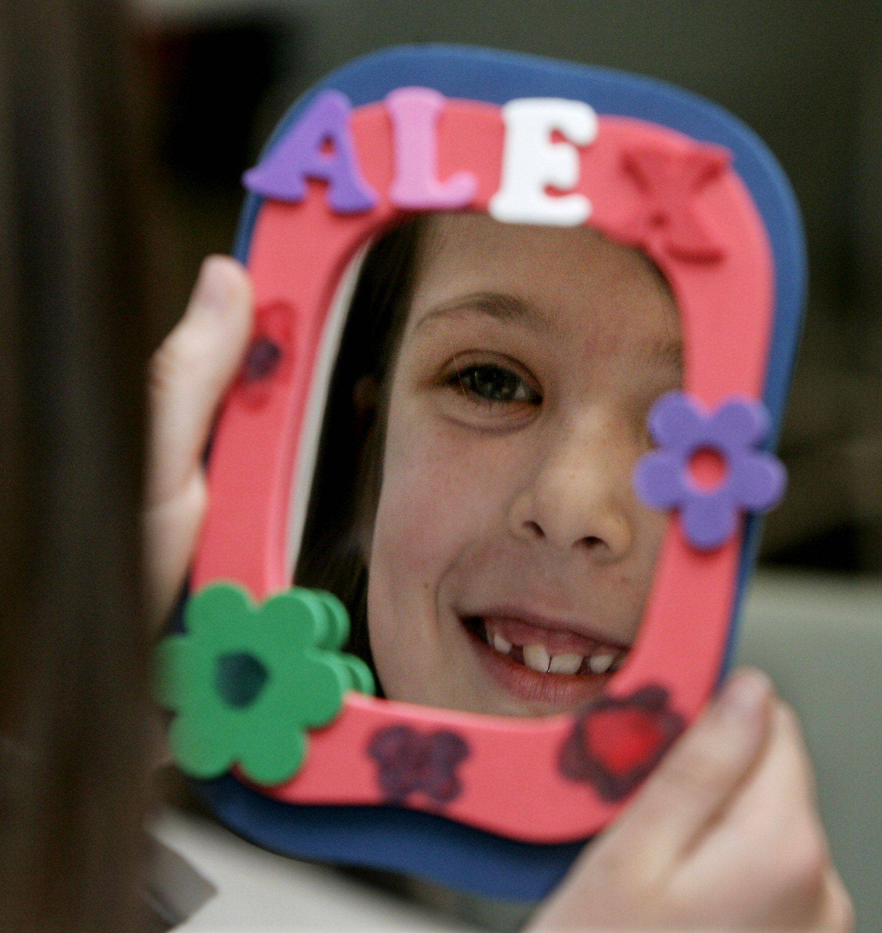 Alex Bryant, 8, of Lindenhurst decorates a mirror as children participate in the Crafts Extravaganza! program Monday at Lake Villa District Library.
