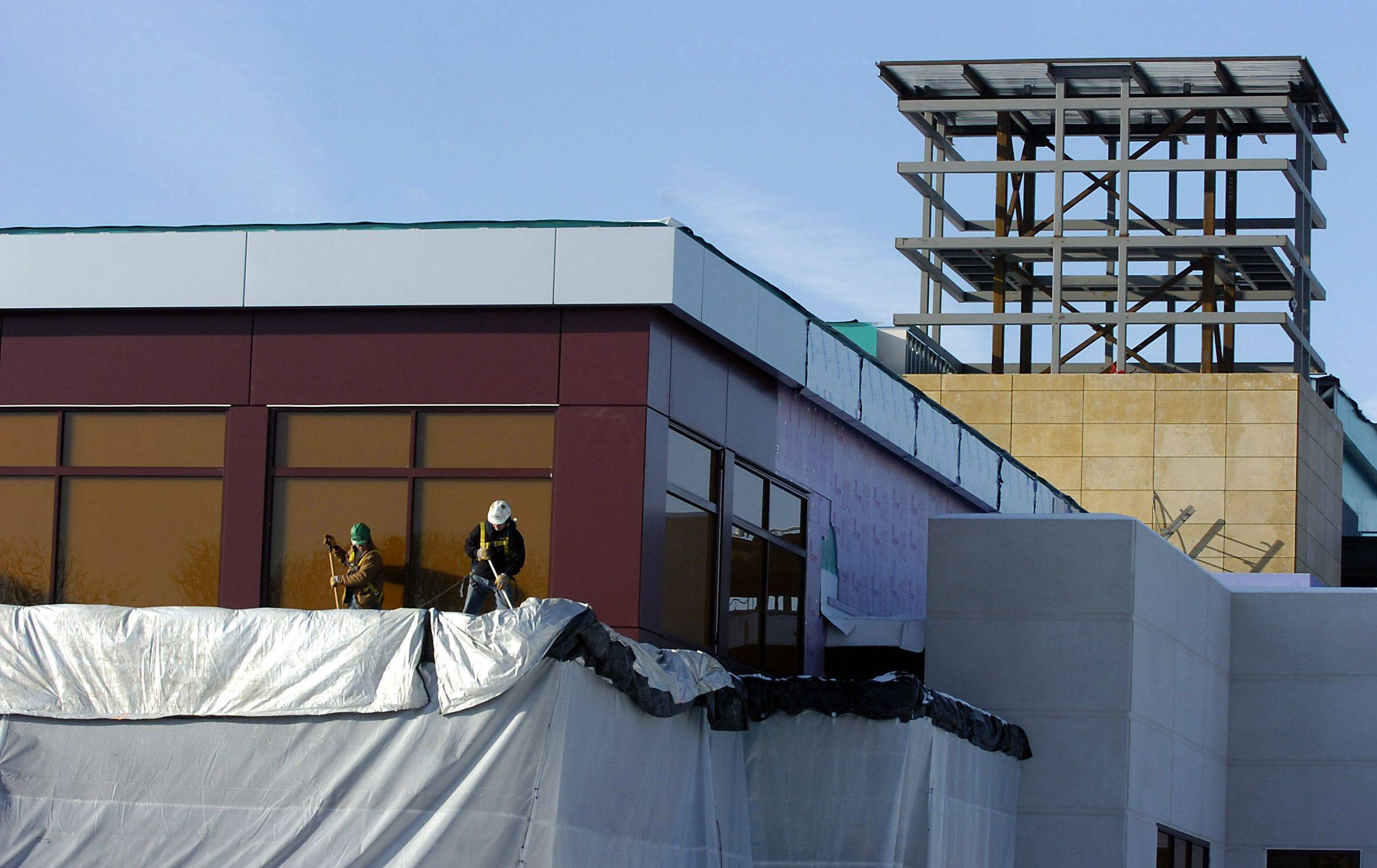 Workers sweep off one of the decks at the new Des Plaines casino under construction along River Road.