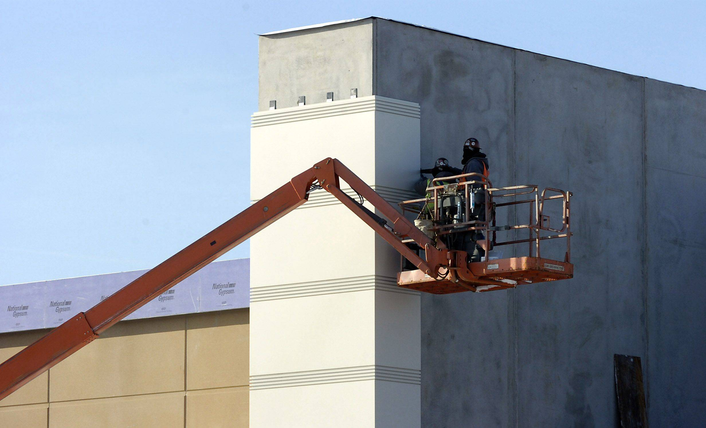 Workers work on the facade at the new Des Plaines casino under construction along River Road.