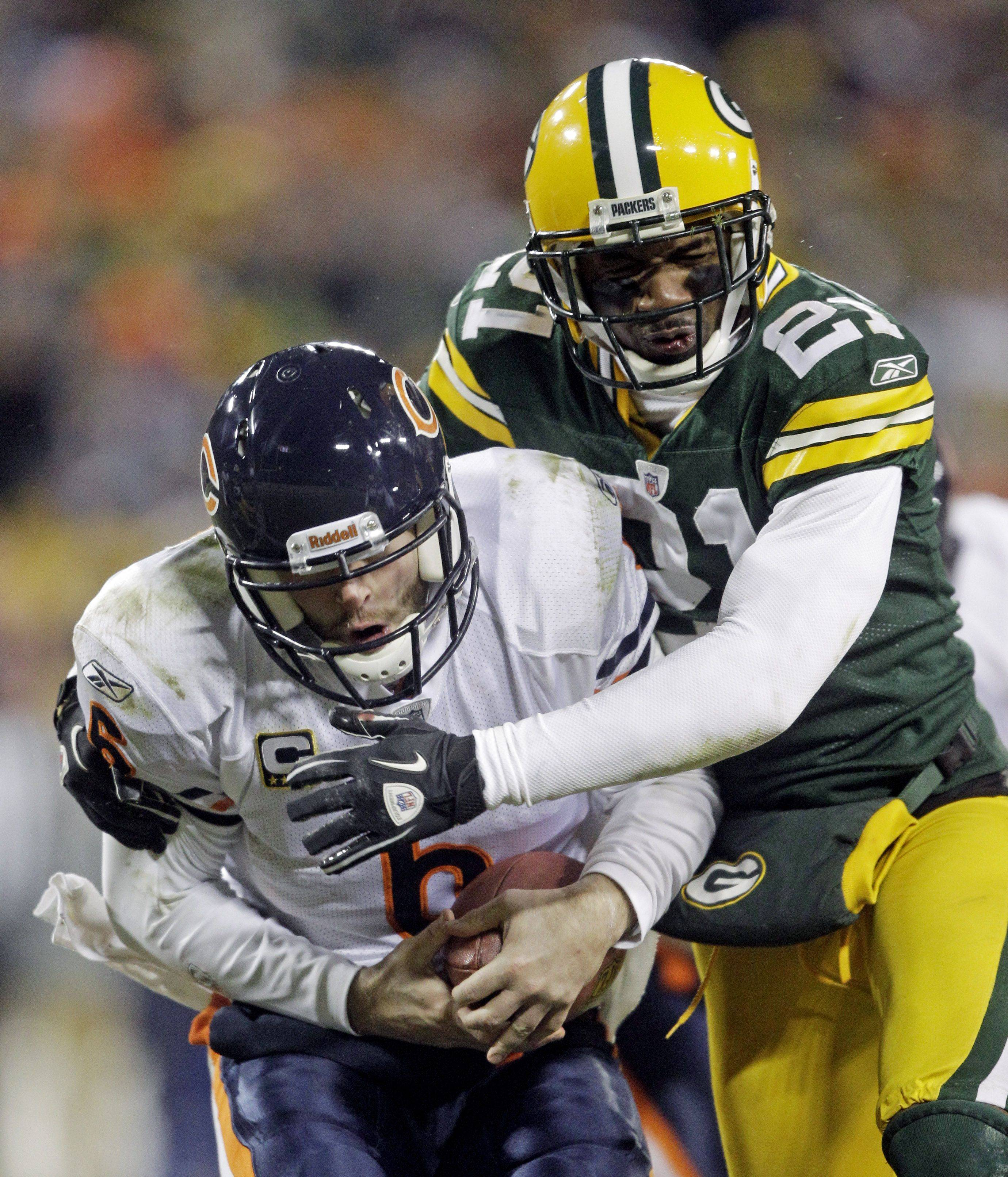 Green Bay Packers' Charles Woodson sacks Chicago Bears quarterback Jay Cutler (6) during the second half of an NFL football game Sunday, Jan. 2, 2011, in Green Bay, Wis. .The Packers won 10-3.