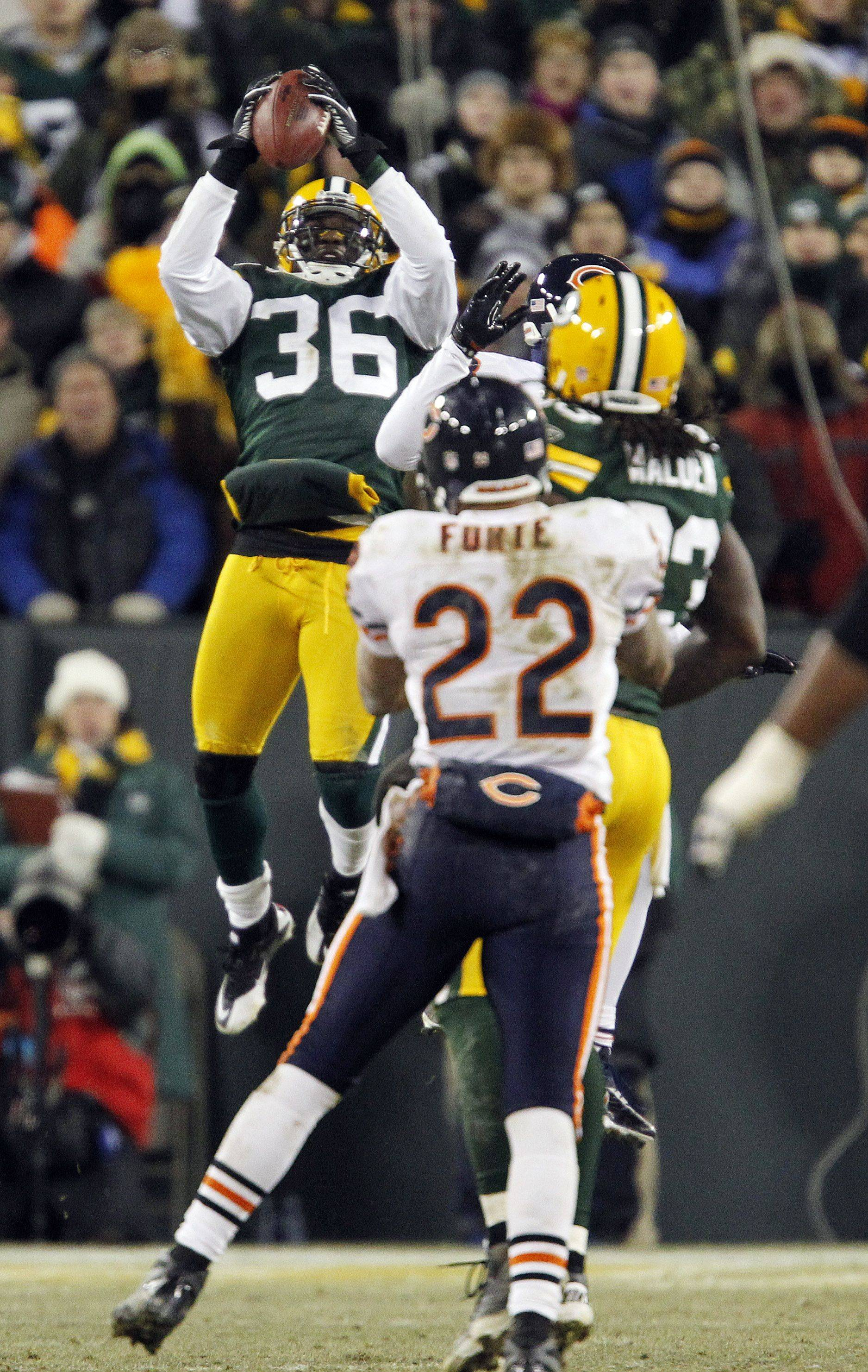 Green Bay Packers' Nick Collins intercepts a pass in the final seconds in the game against the Chicago Bears.