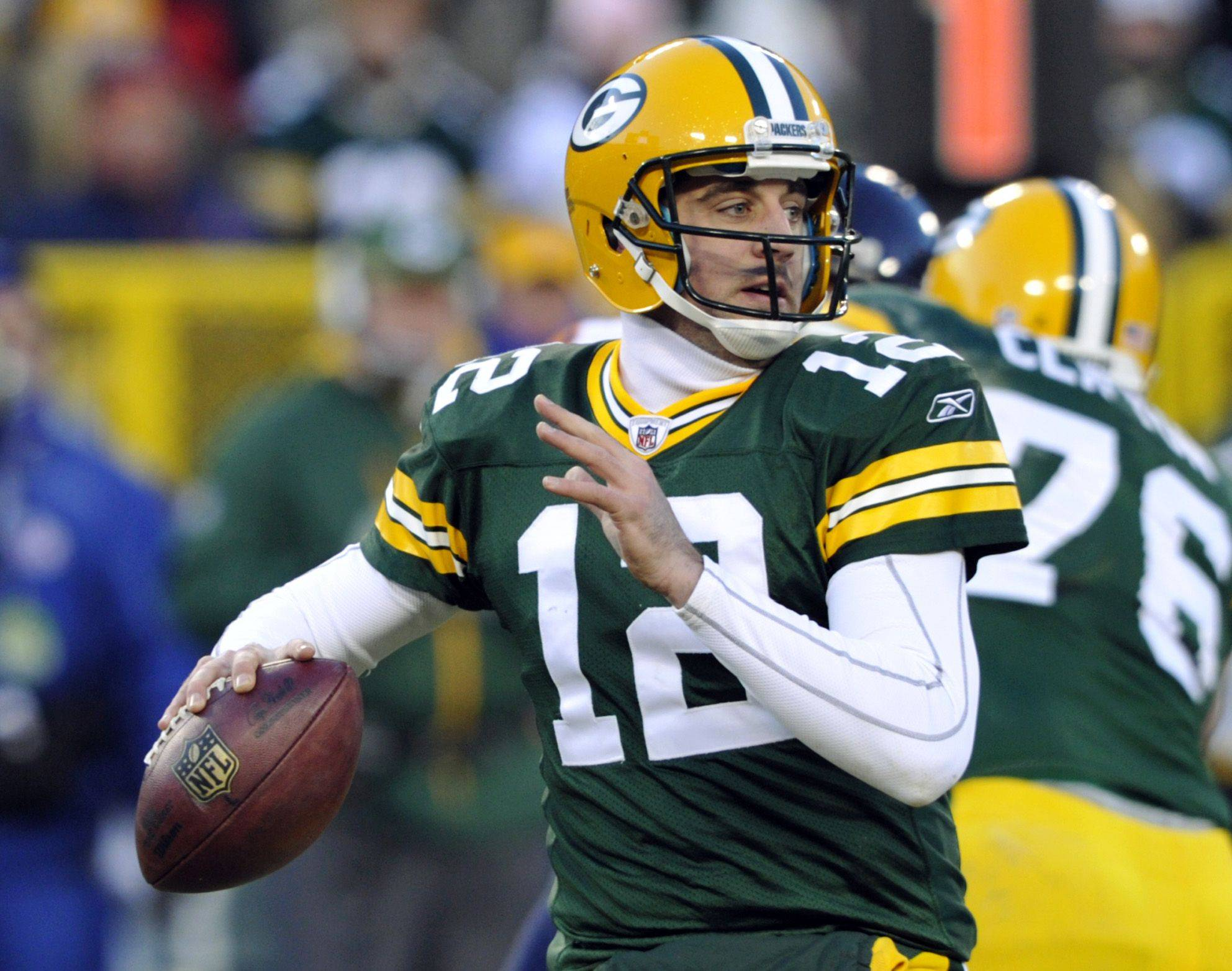 Green Bay Packers quarterback Aaron Rodgers drops back to pass during the first half.