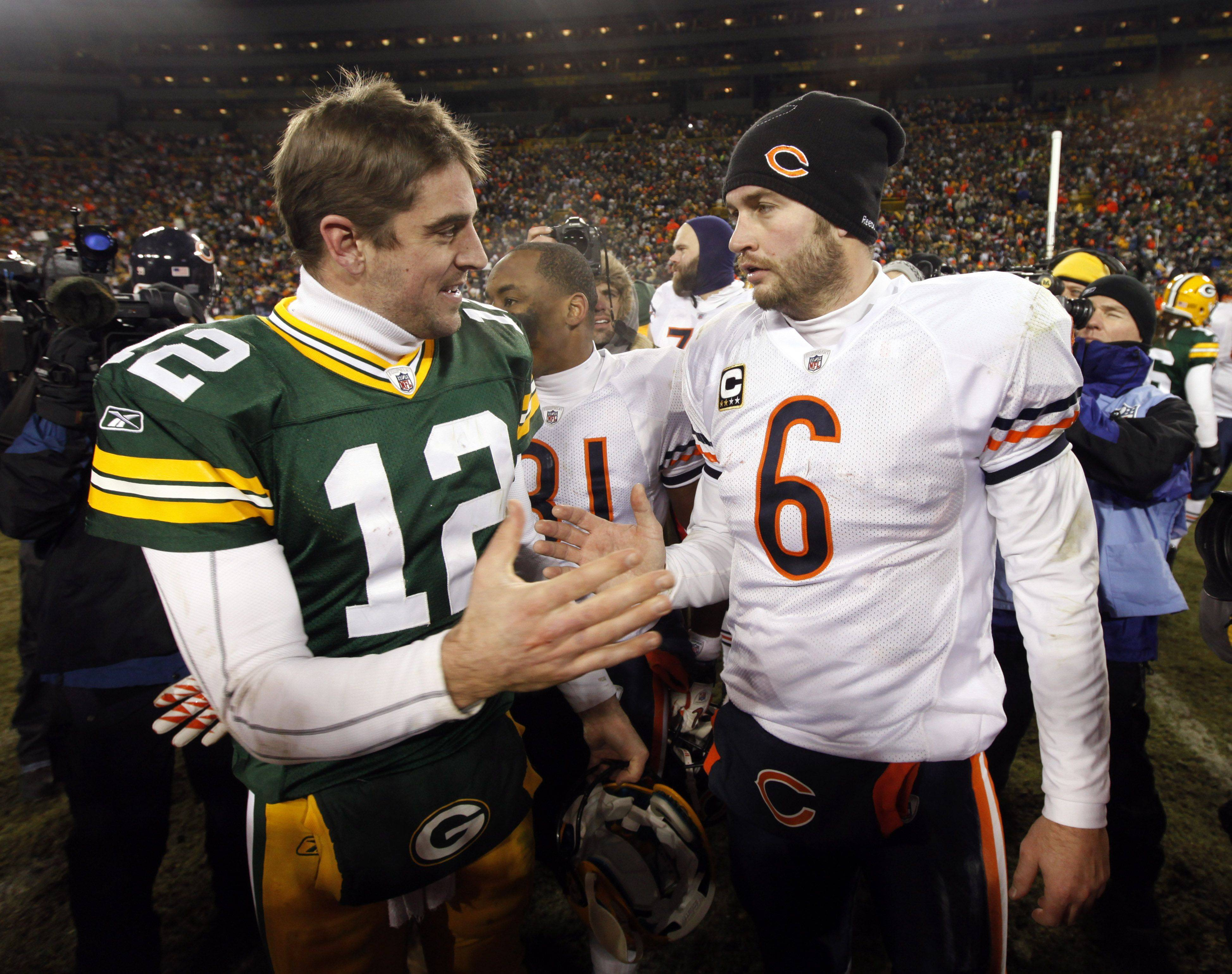 Green Bay Packers quarterback Aaron Rodgers talks to Chicago Bears quarterback Jay Cutler after the Packers won the game.