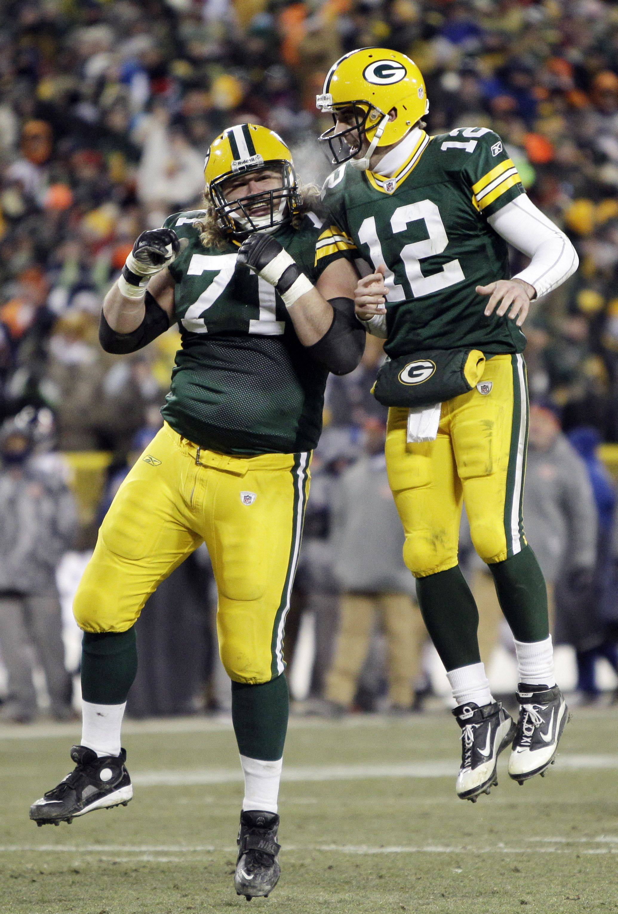 Green Bay Packers quarterback Aaron Rodgers celebrates with Josh Sitton after Rodgers threw a touchdown pass to Donald Lee during the second half.
