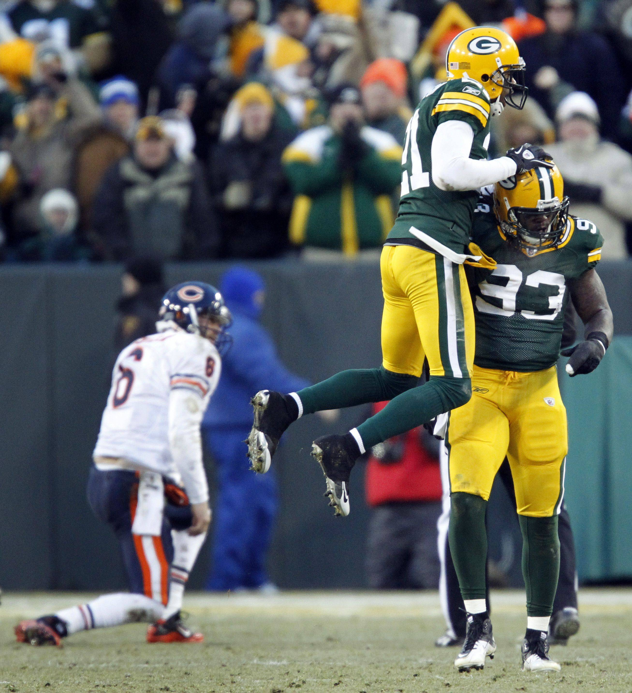 Green Bay Packers' Erik Walden is congratulated by Charles Woodson after Walden sacked Chicago Bears quarterback Jay Cutler during the first half.