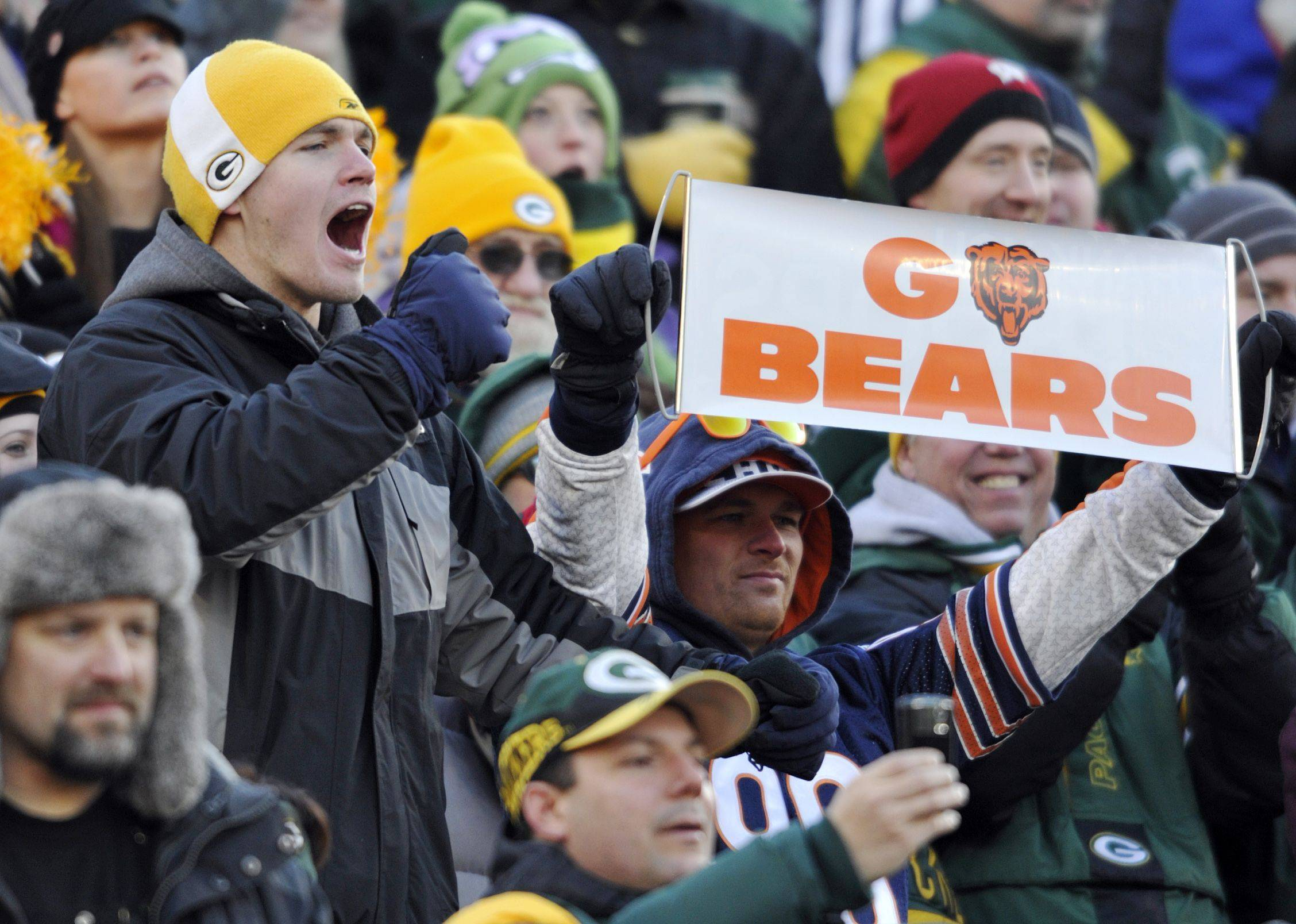 Fans cheer during the first half of an NFL football game between the Green Bay Packers and the Chicago Bears.