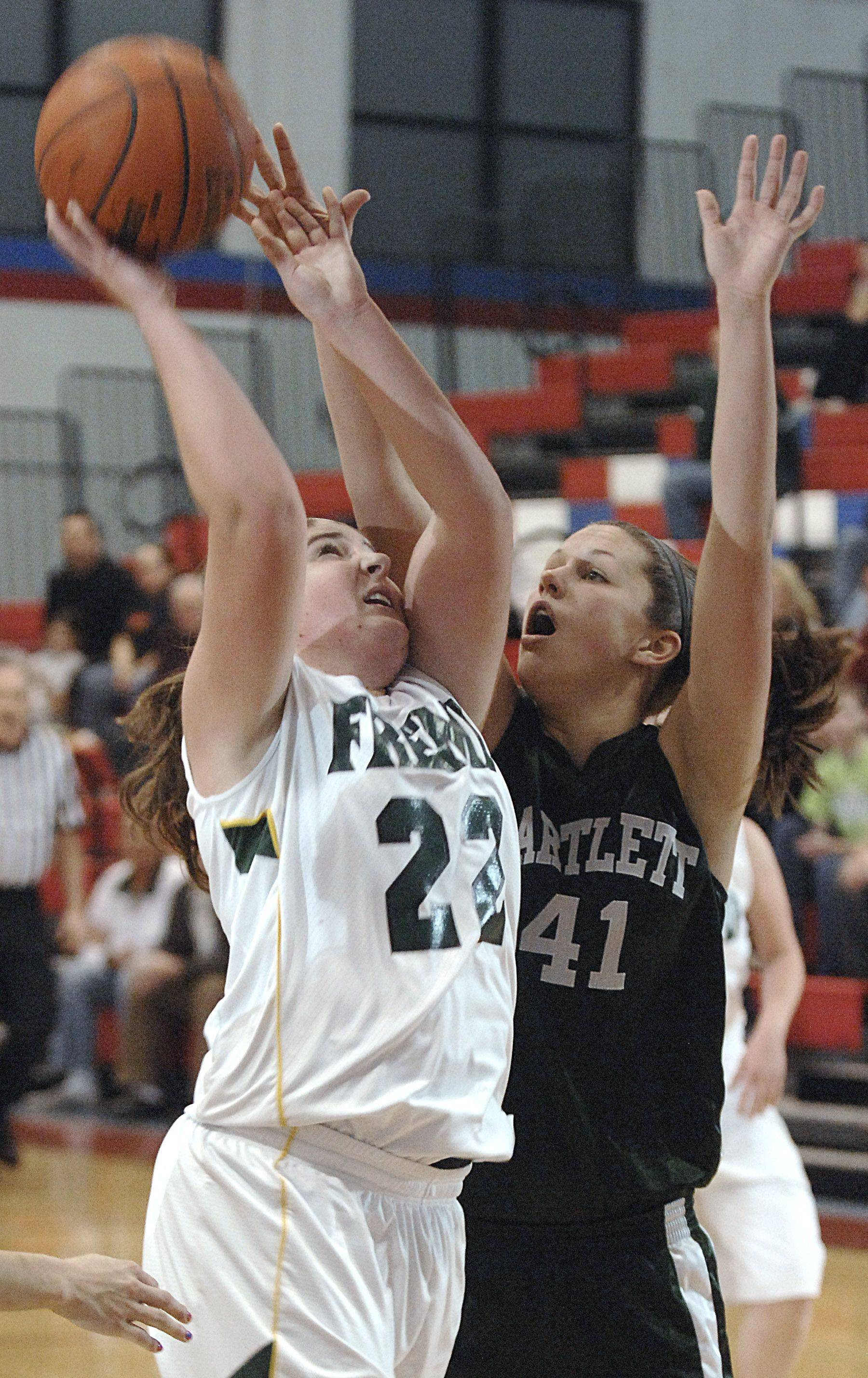 Fremd's Megan Horn shoots over Bartlett's Lisa Palmer the Dundee-Crown tournament in Carpentersville Wednesday.