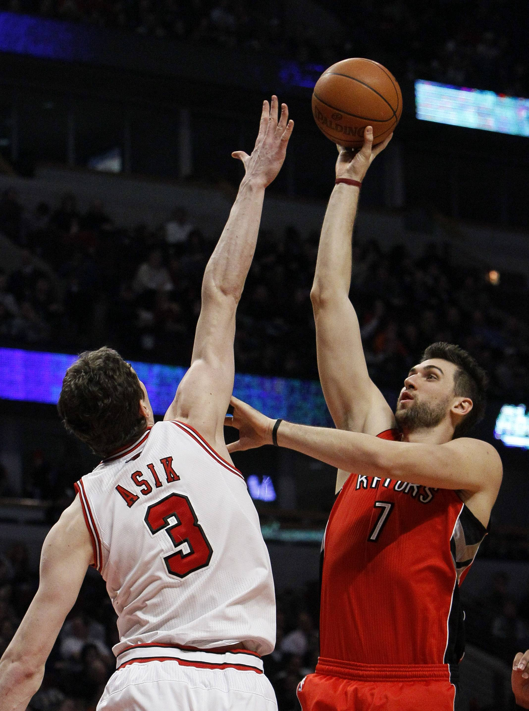 Toronto Raptors center Andrea Bargnani tries to shoot over Bulls center Omer Asik. Asik had a career-high 13 points and seven rebounds.