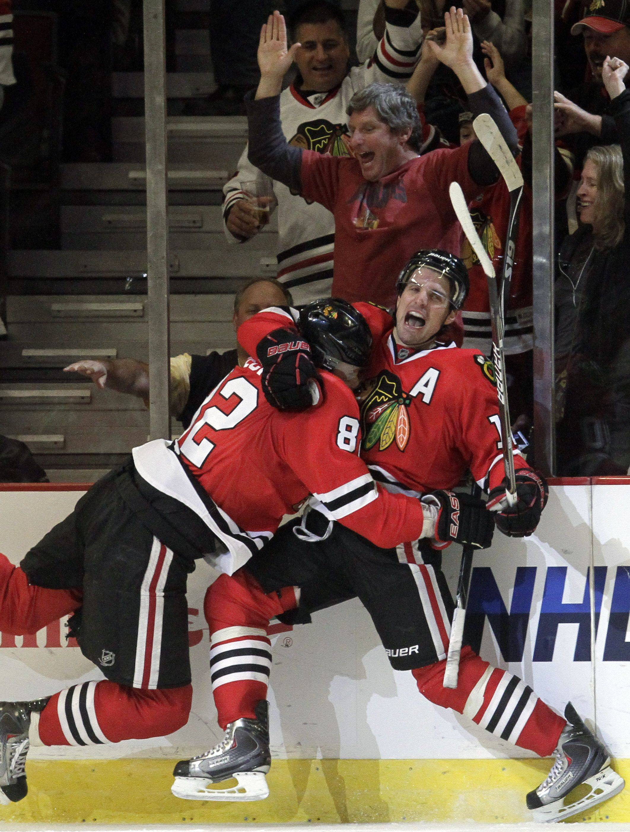 One of the positives in the first half of the Blackhawks season has been the offensive production of Patrick Sharp, right, who celebrated one of his game-winning goals with teammate Tomas Kopecky.
