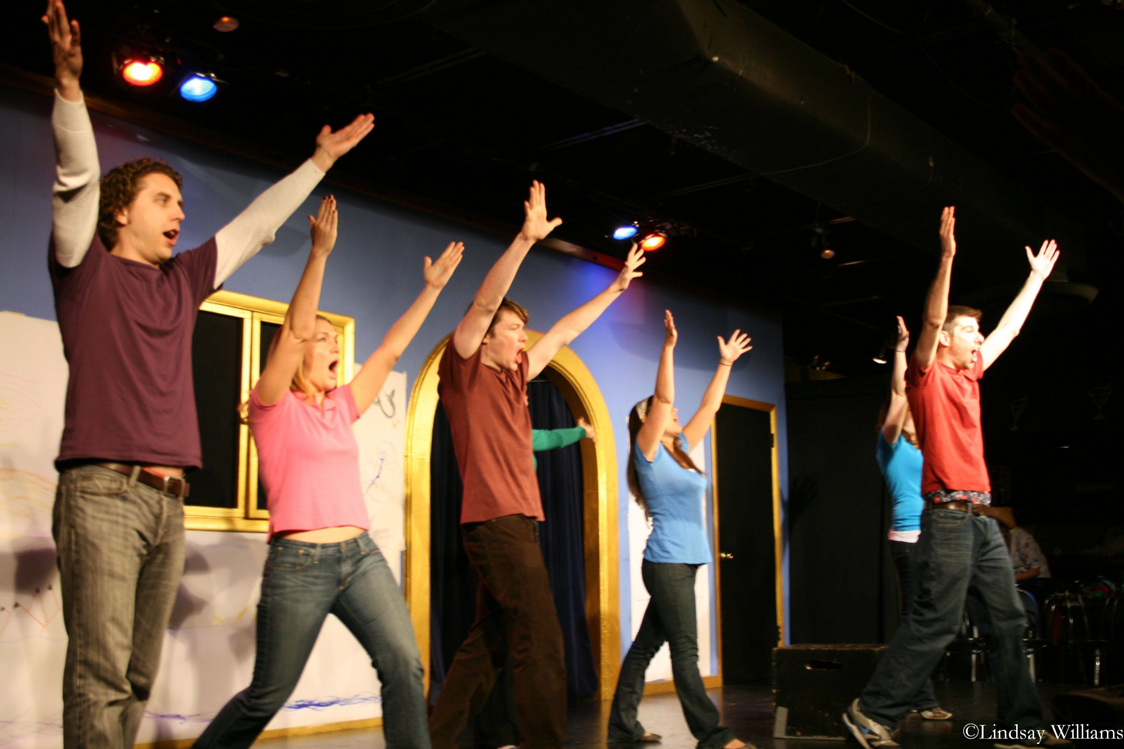 Tim Stoltenberg, left, Julie Poteet, Austin Campion, Rachel Grandi and John Sabine comprise Storytown, which includes children from the audience in its interactive improv performances.