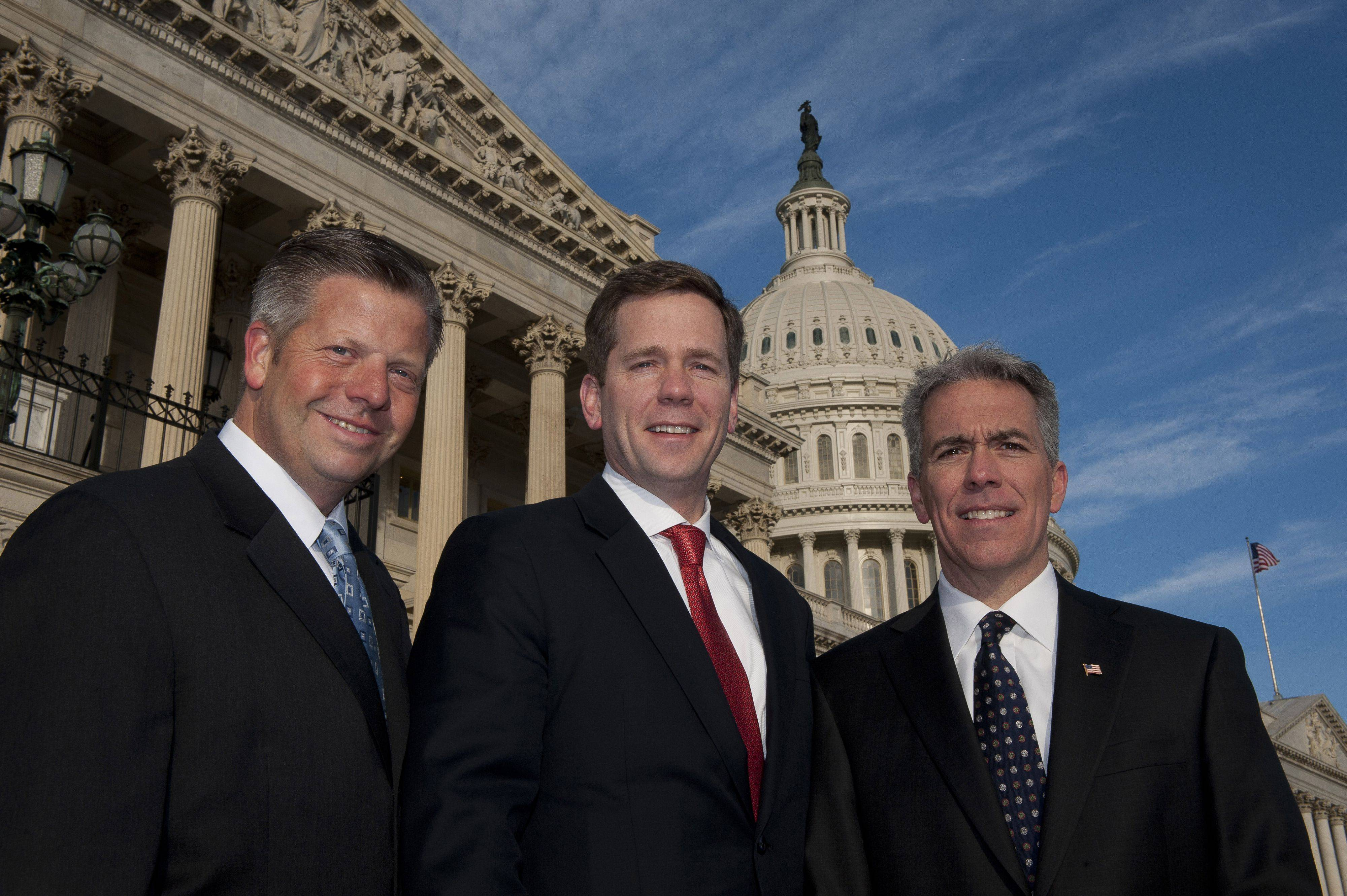 New Illinois Congressmen Randy Hultgren, left, Bob Dold, Joe Walsh get ready to start work in Washington, D.C., on Wednesday.