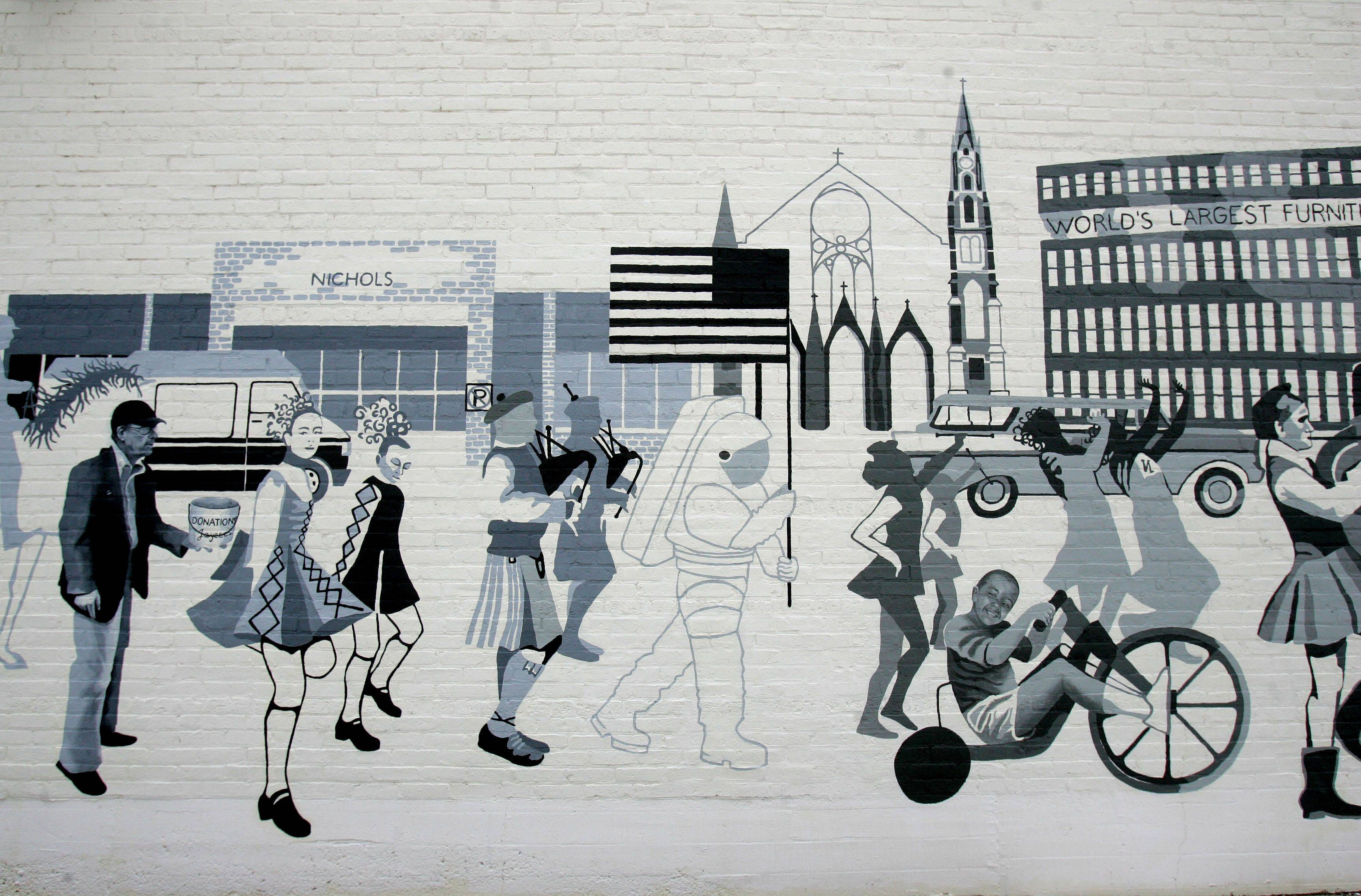 Artist Adela Vystejnova Gartner's mural features a parade starting with scenes from 1900 and continuing through the present.