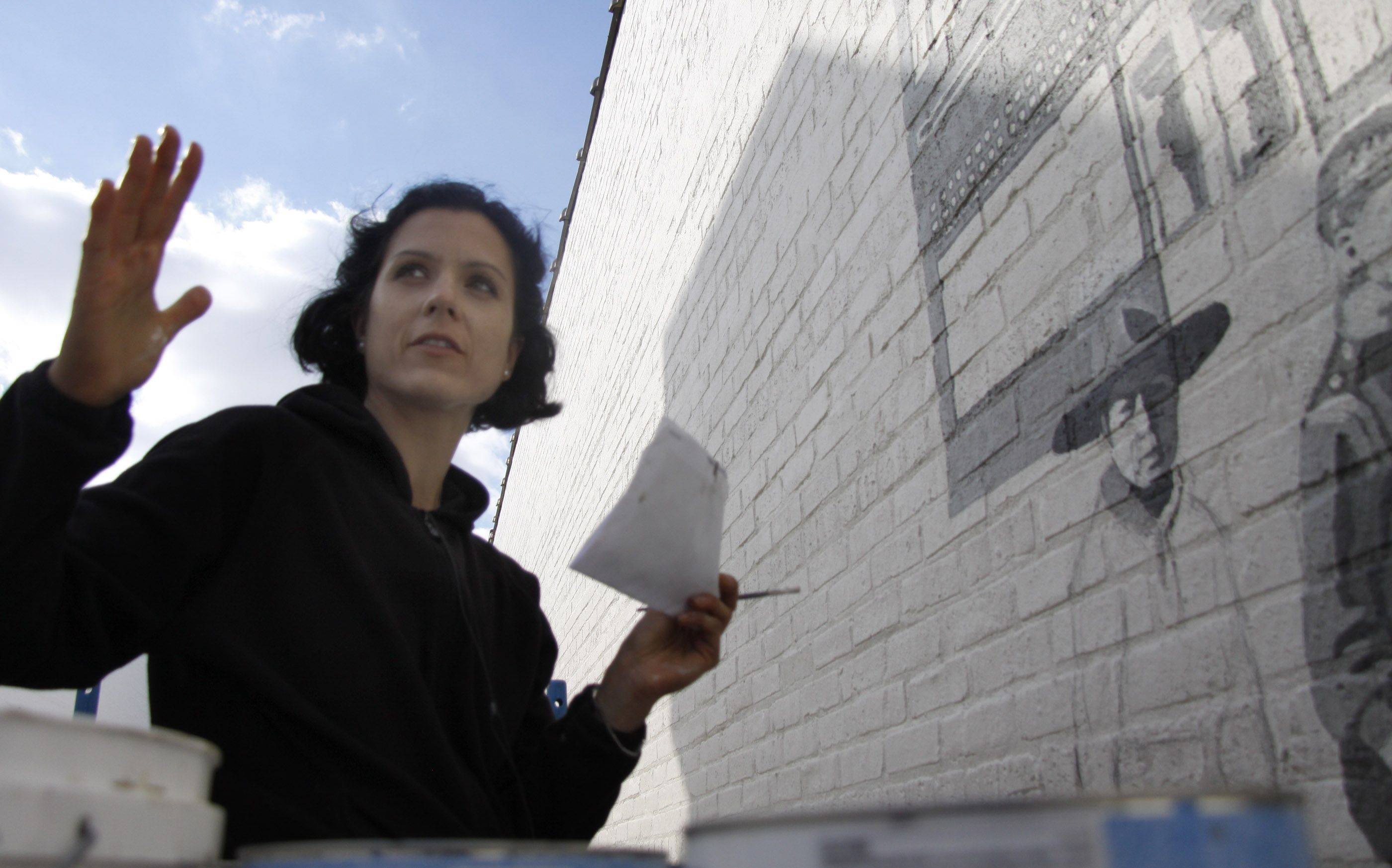Adela Vystejnova Gardner began painting her mural in downtown Naperville in October and worked through to the winter to finish. She'll begin work on the second piece on Monday. She says it's the first time she's ever done a mural outside.