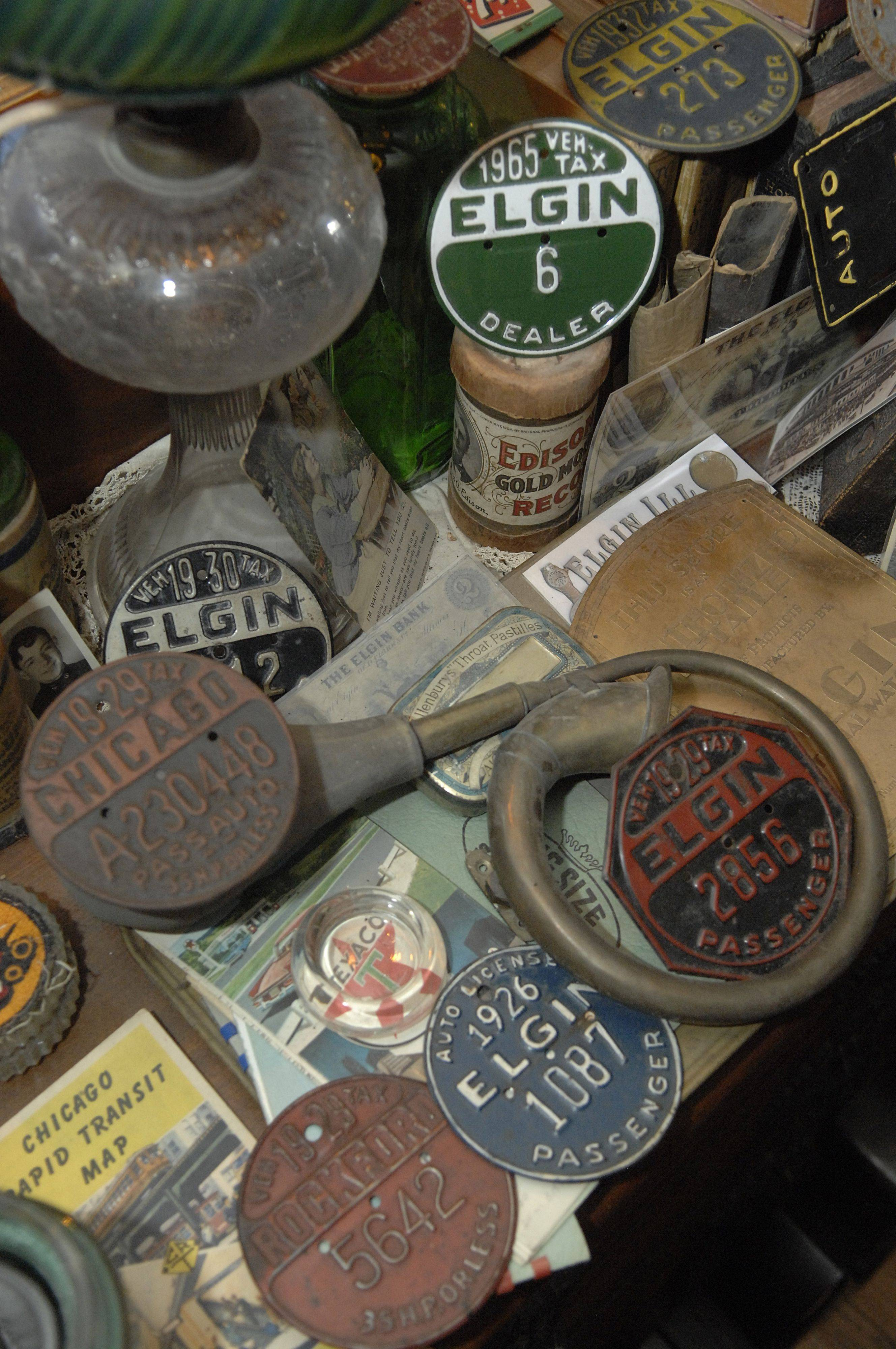 A table full of Elgin memorabilia is displayed in Thoren's living room.