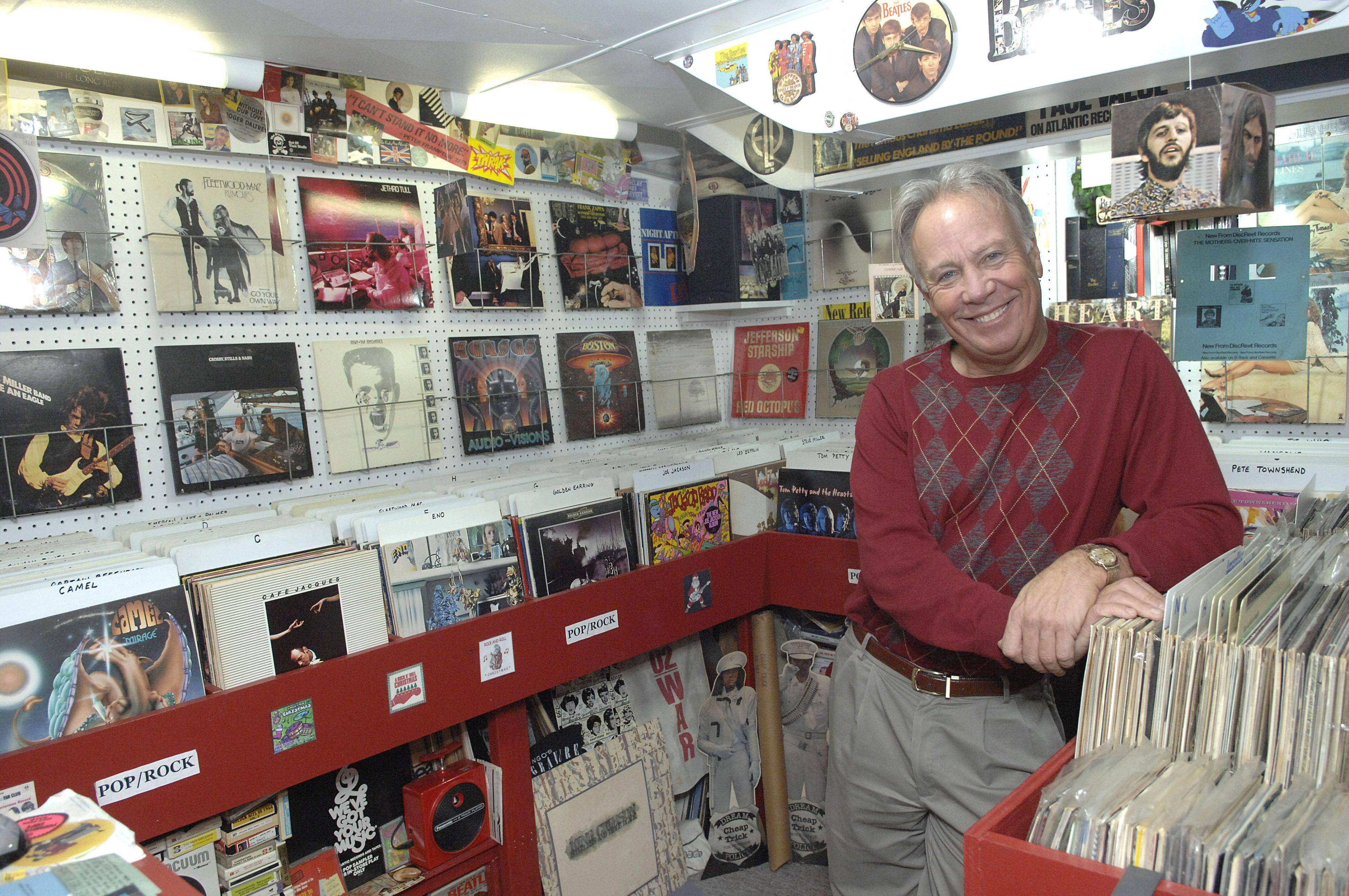 Steve Thoren stands in the newest room in the house, the record shop, which stores a part of his 8,000 records. This room was completed a year and a half ago.