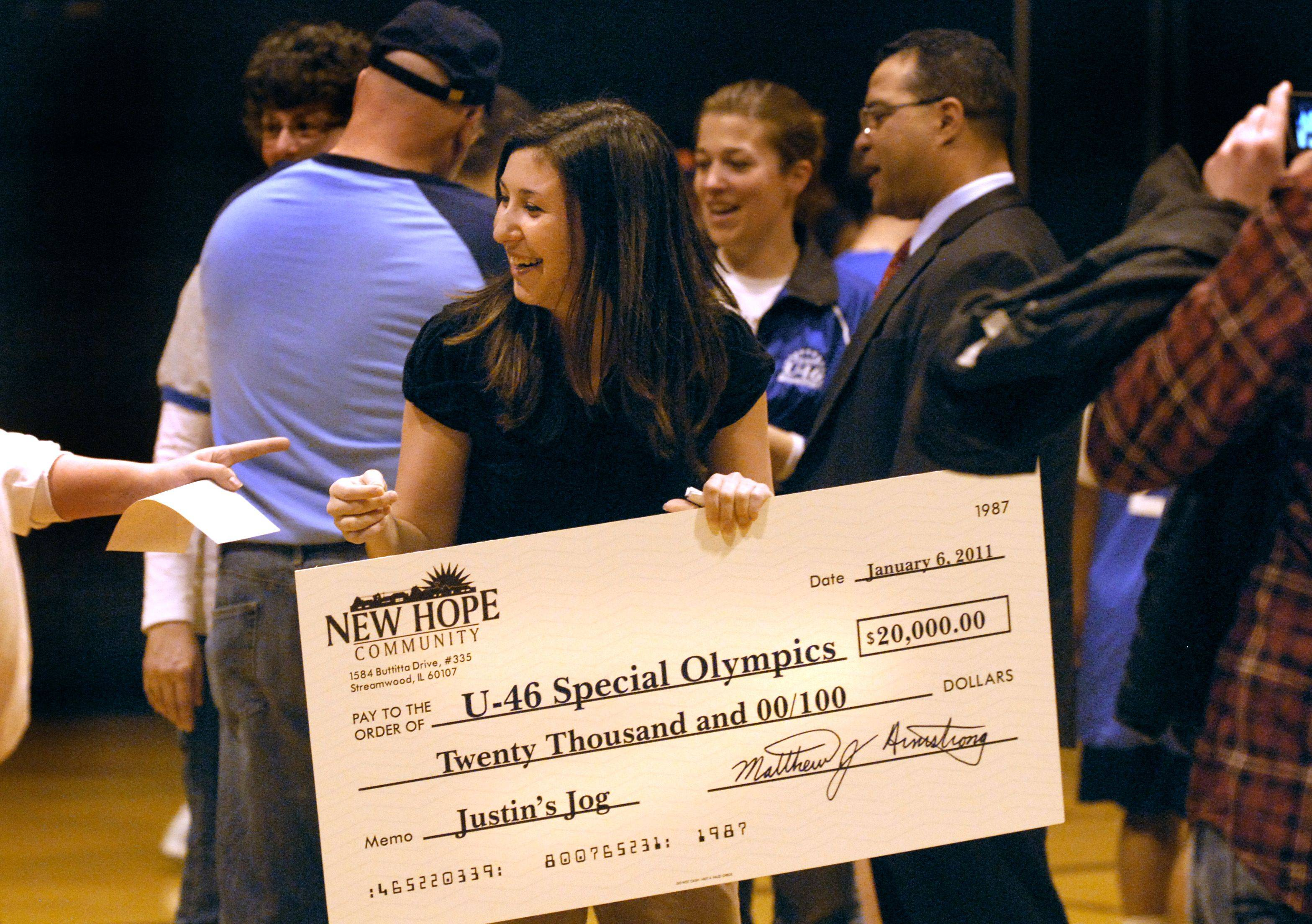 In memory of her boyfriend, Mary Bares of Streamwood presents the 20,000 dollar check to U46 Special Olympics Thursday night at Gifford Street Alternative High School. The proceeds will benefit the district's track, basketball, and bowling Special Olympics programs. Bares raised the money through donations.