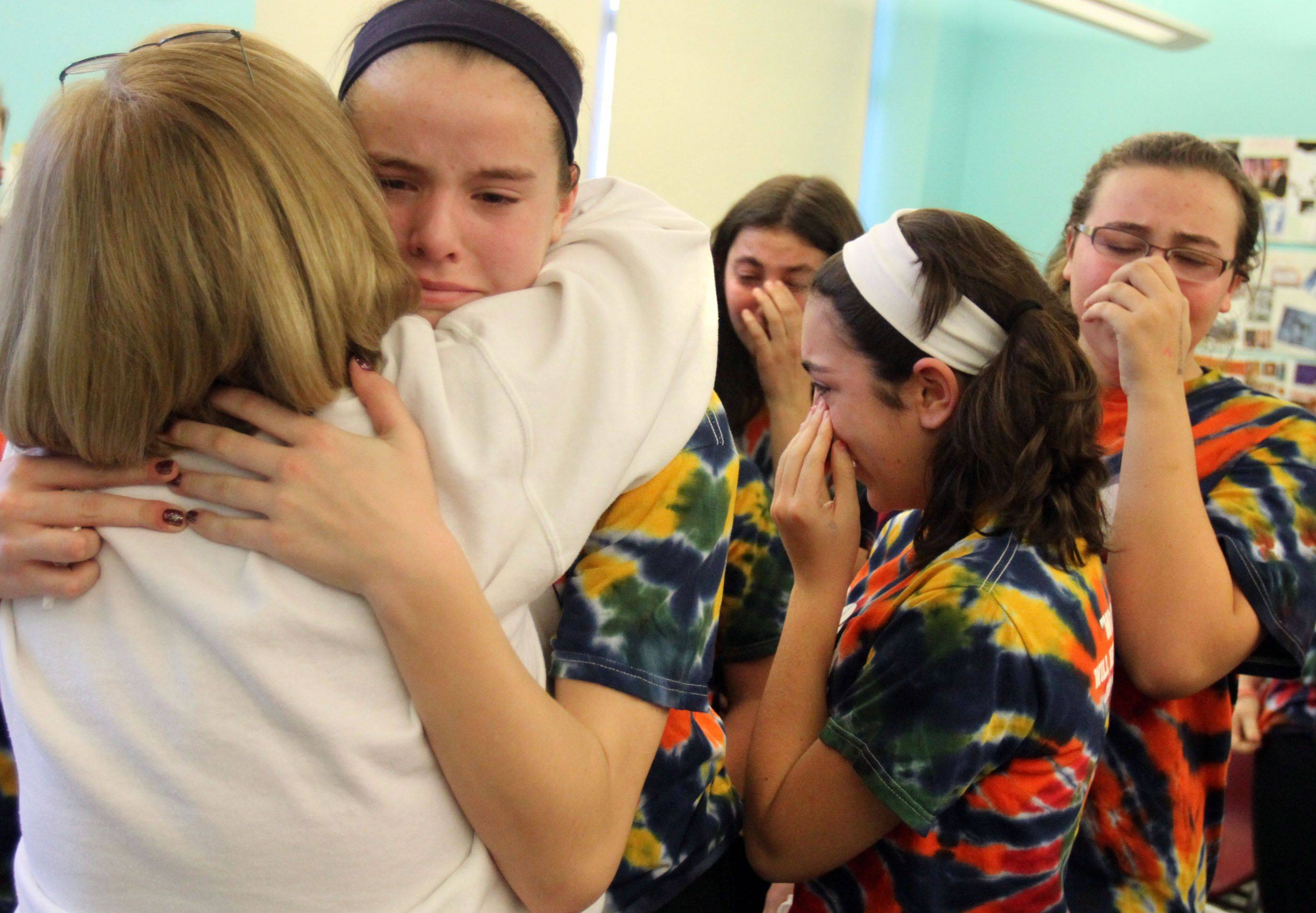 Debbie Sykes gets a hug from eighth grader Catherine Sherwood after St. Raymond students held an event to celebrate the life of former classmate Joey Sykes. The students presented his parents, Joe and Debbie Sykes, with a framed photograph of the St. Raymond Class of 2011 at the school in Mount Prospect on Thursday, January 6. The Mount Prospect school hosted its seventh-annual Joey Sykes Boys Basketball Tournament Thursday night, named after Joey, who died of cancer.
