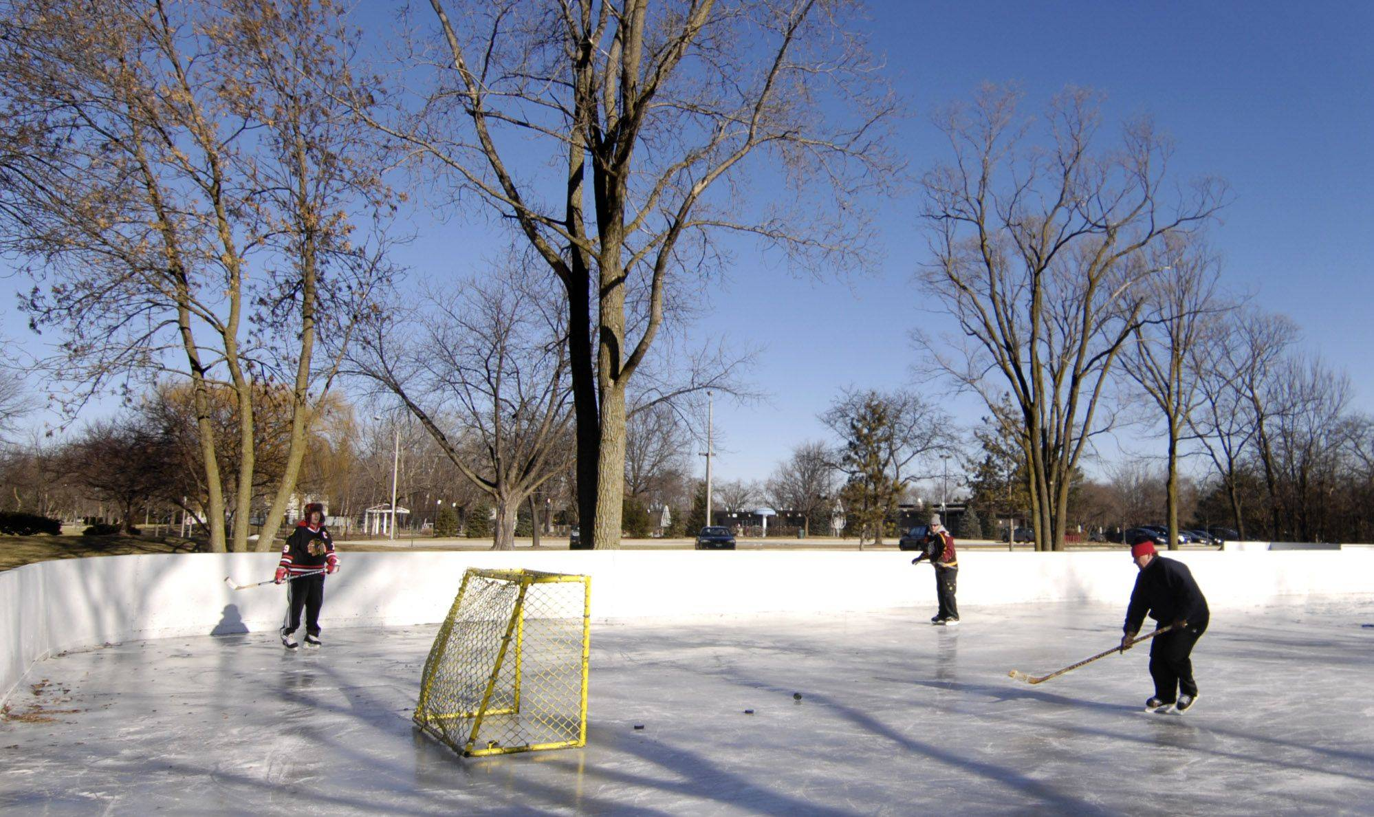 Chris Poznanski of Palatine, Phil Howe of Palatine and Dave Janson of Arlington Heights play some hockey at Frontier Park in Arlington Heights.