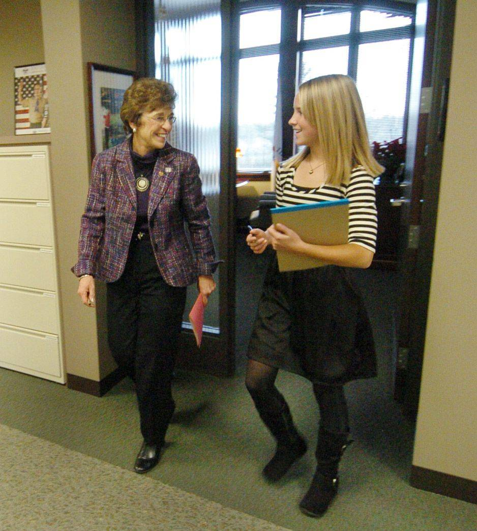 Thomas Middle School eighth grader Brianna Kolbus shadows Arlington Heights Mayor Arlene Mulder. Here they are leaving the mayor's office on their way to a liquor hearing.