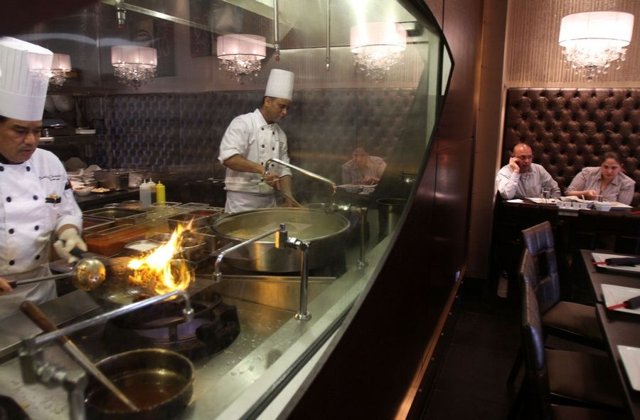 Customers can watch the chefs from the dining room at Bombay Chopsticks in Hoffman Estates.