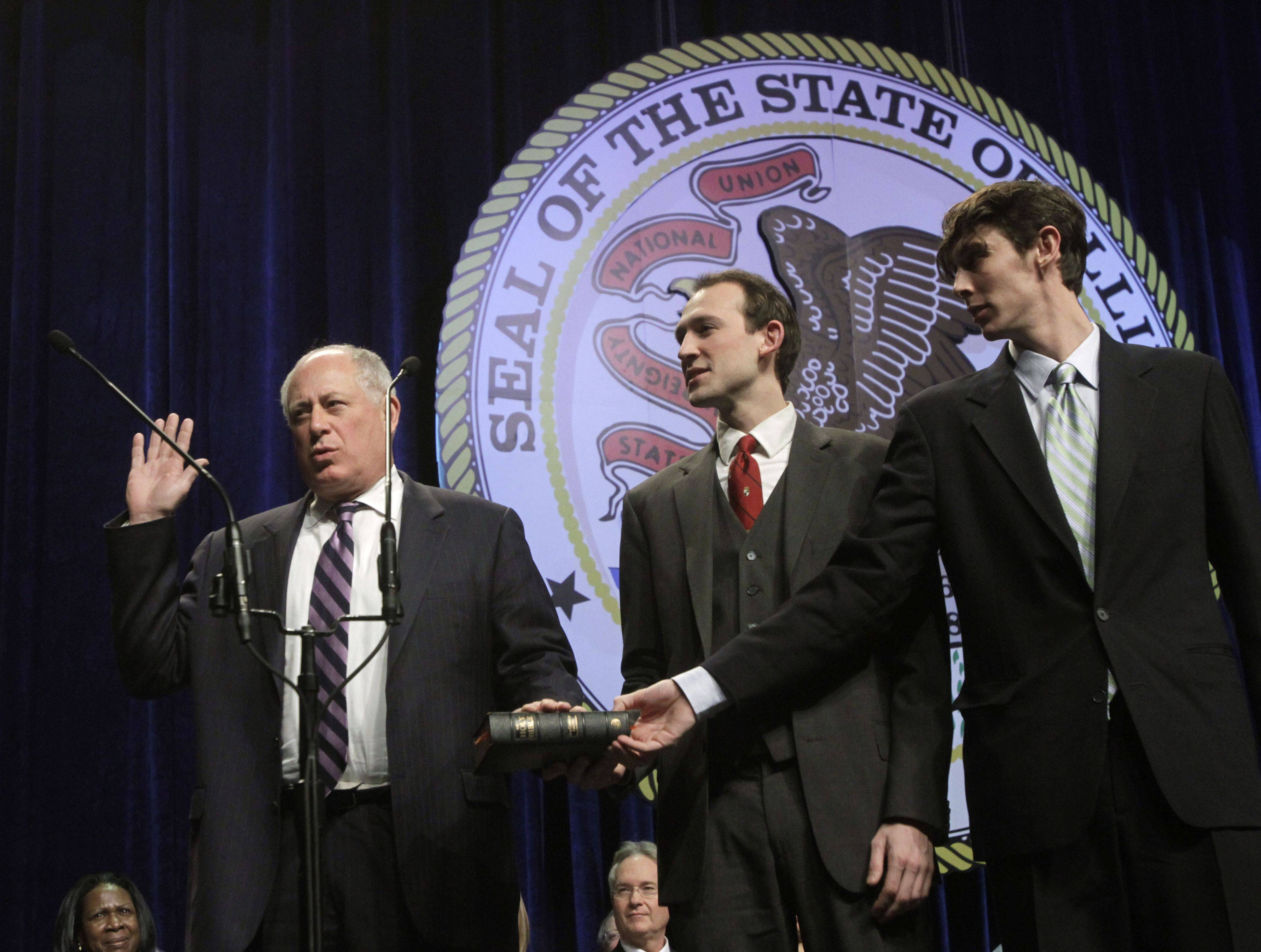 Illinois Gov. Pat Quinn, center, takes the oath of office of governor, from Illinois Supreme Court Justice Anne M. Burke, as Quinn's sons Patrick and David watch during inaugural ceremonies Monday, Jan. 10, 2011 in Chicago.