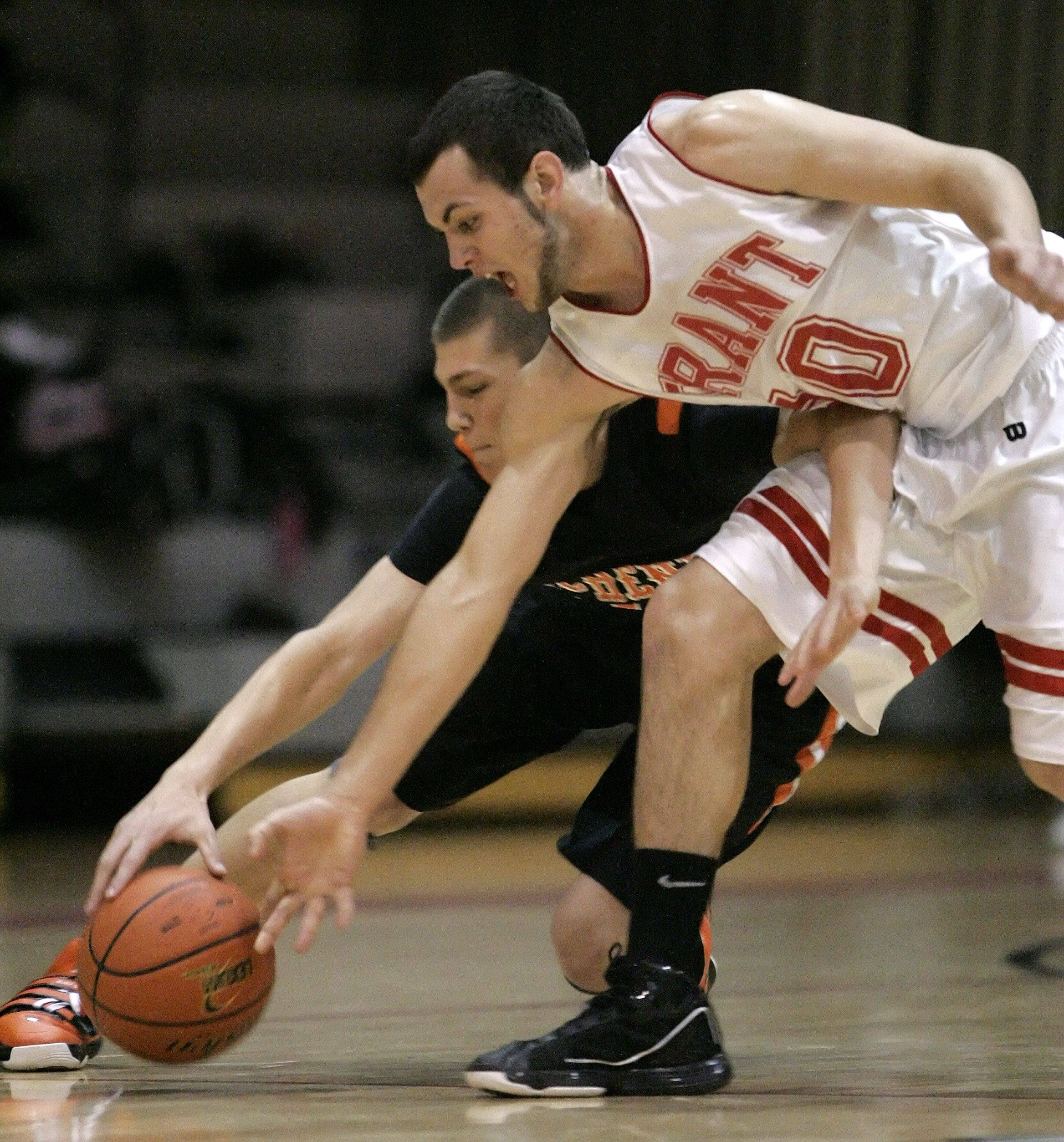 Grant's Jerry Gaylor, right, and McHenry's Robert Tonyan battle for a loose ball in Fox Lake Wednesday.