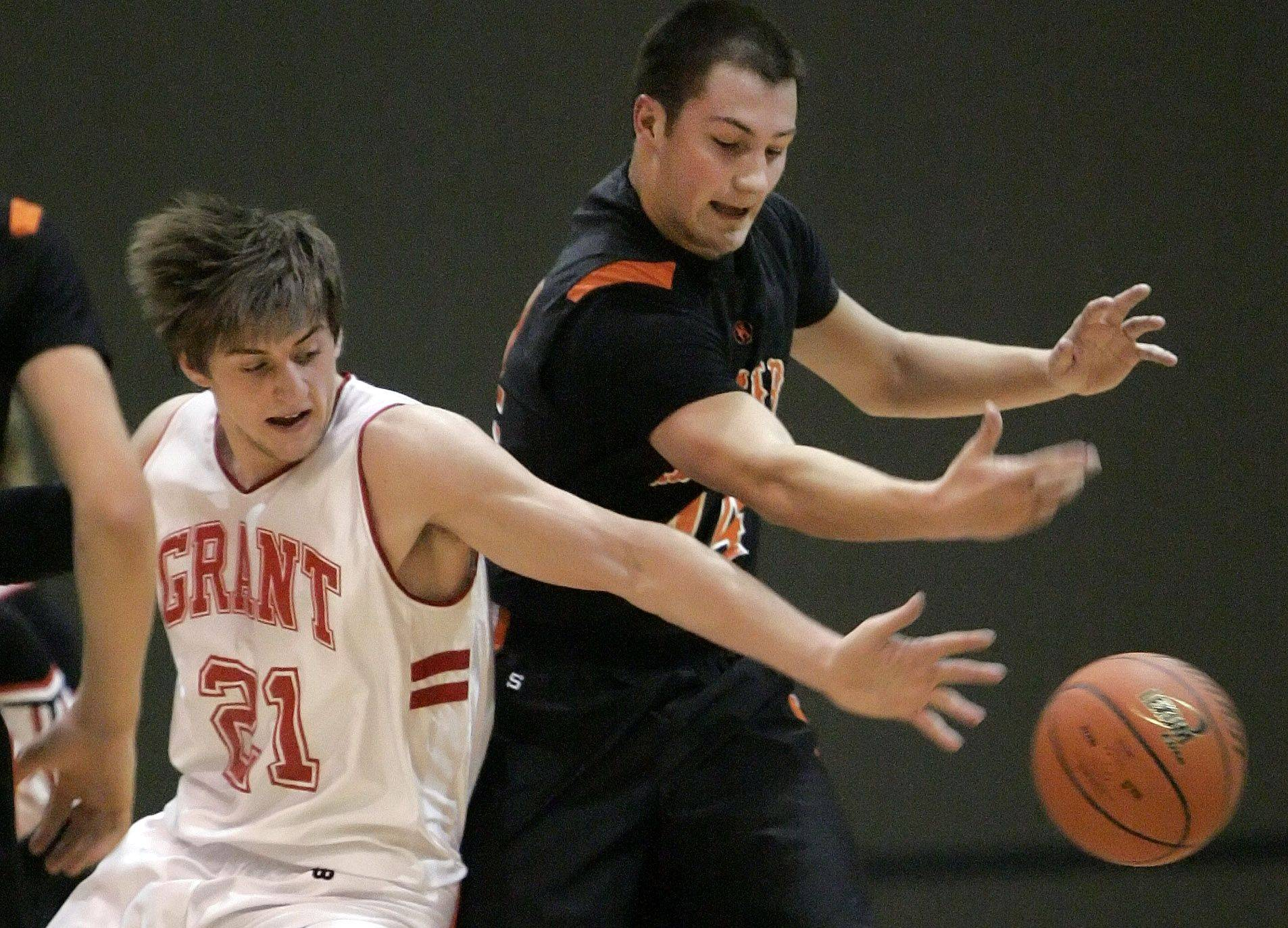Grant's Ilya Kadushin, left, and McHenry's Jimmy Preston battle for a loose ball in Fox Lake Wednesday.