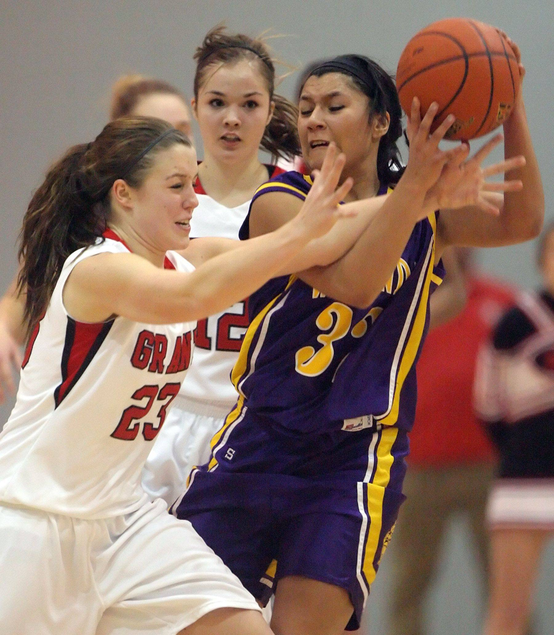 Grant's Caitlin Wedge, left, and Wauconda's Diana Enriquez battle for a loose ball Tuesday in Fox Lake.